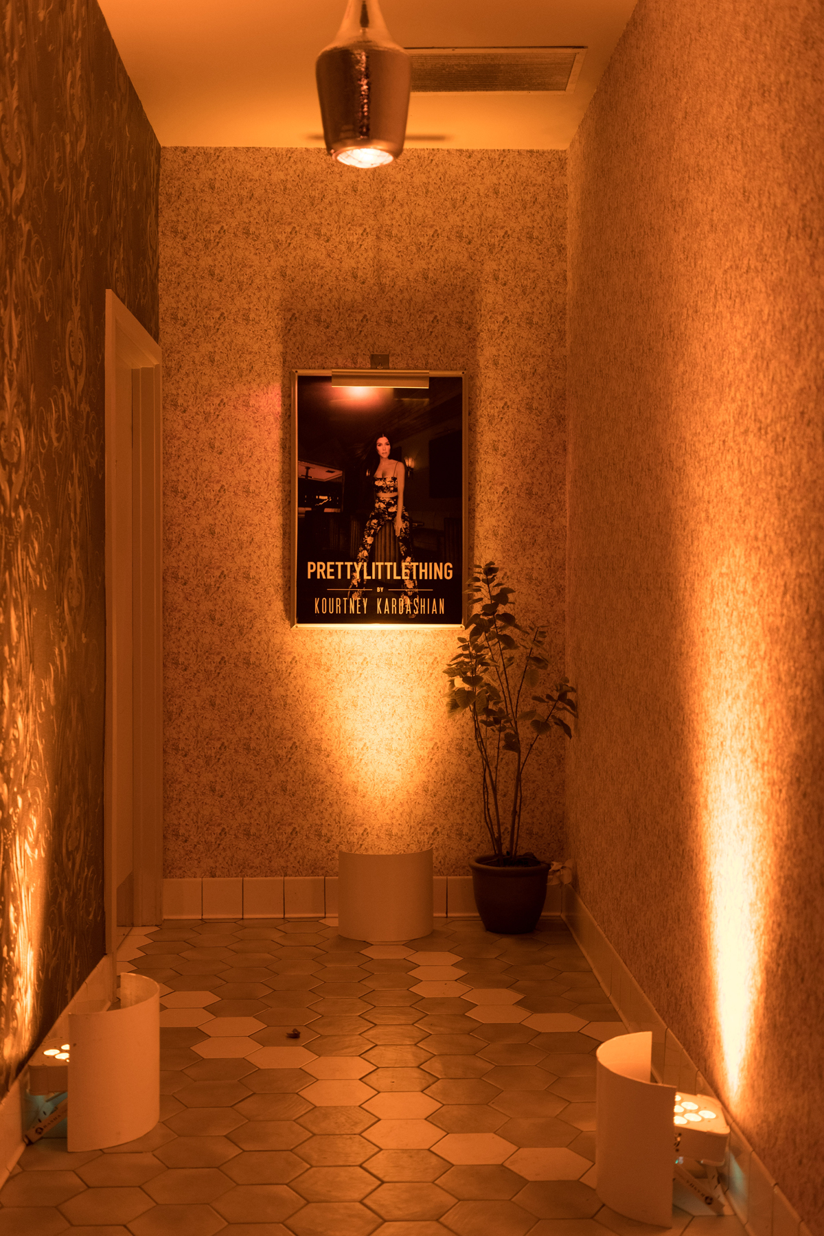 PrettyLittleThing PLT X Kourtney Kardashian Collection Celebrity Launch Party even the restroom entrance was decorated.jpg