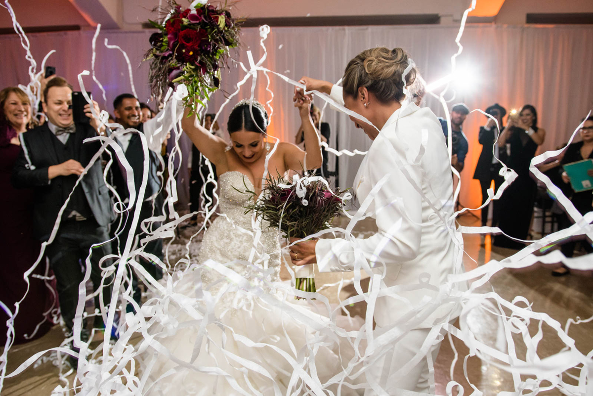She Stole Her Heart Wedding Sneak Peek streamers at reception.jpg