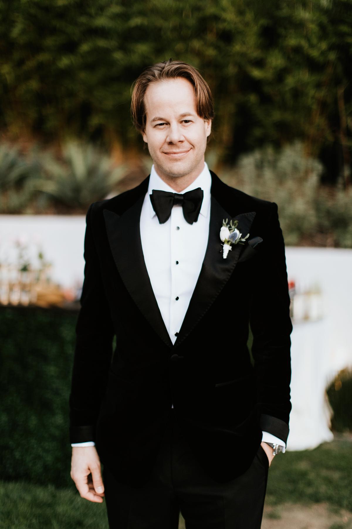 Dreamy Starry Nights Wedding groom standing in tux by the pool.jpg