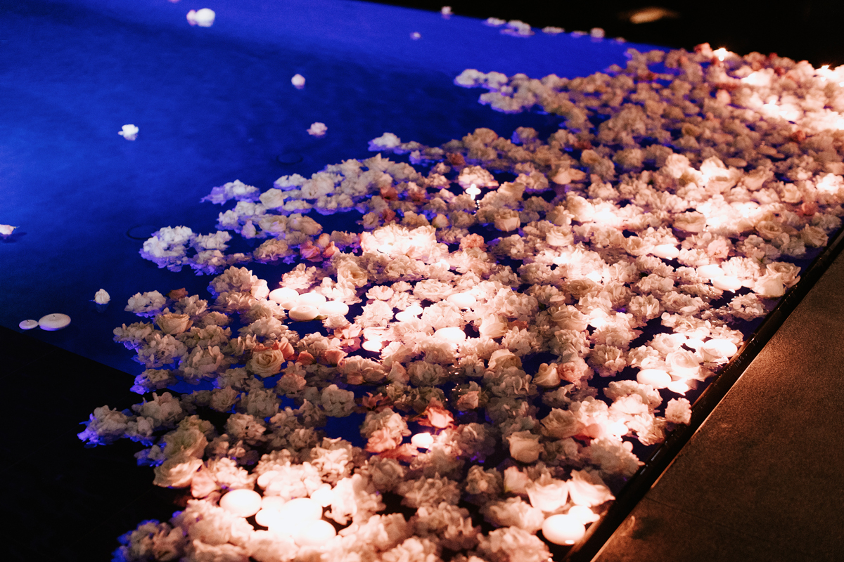Dreamy Starry Nights Wedding flowers fill the pool.jpg