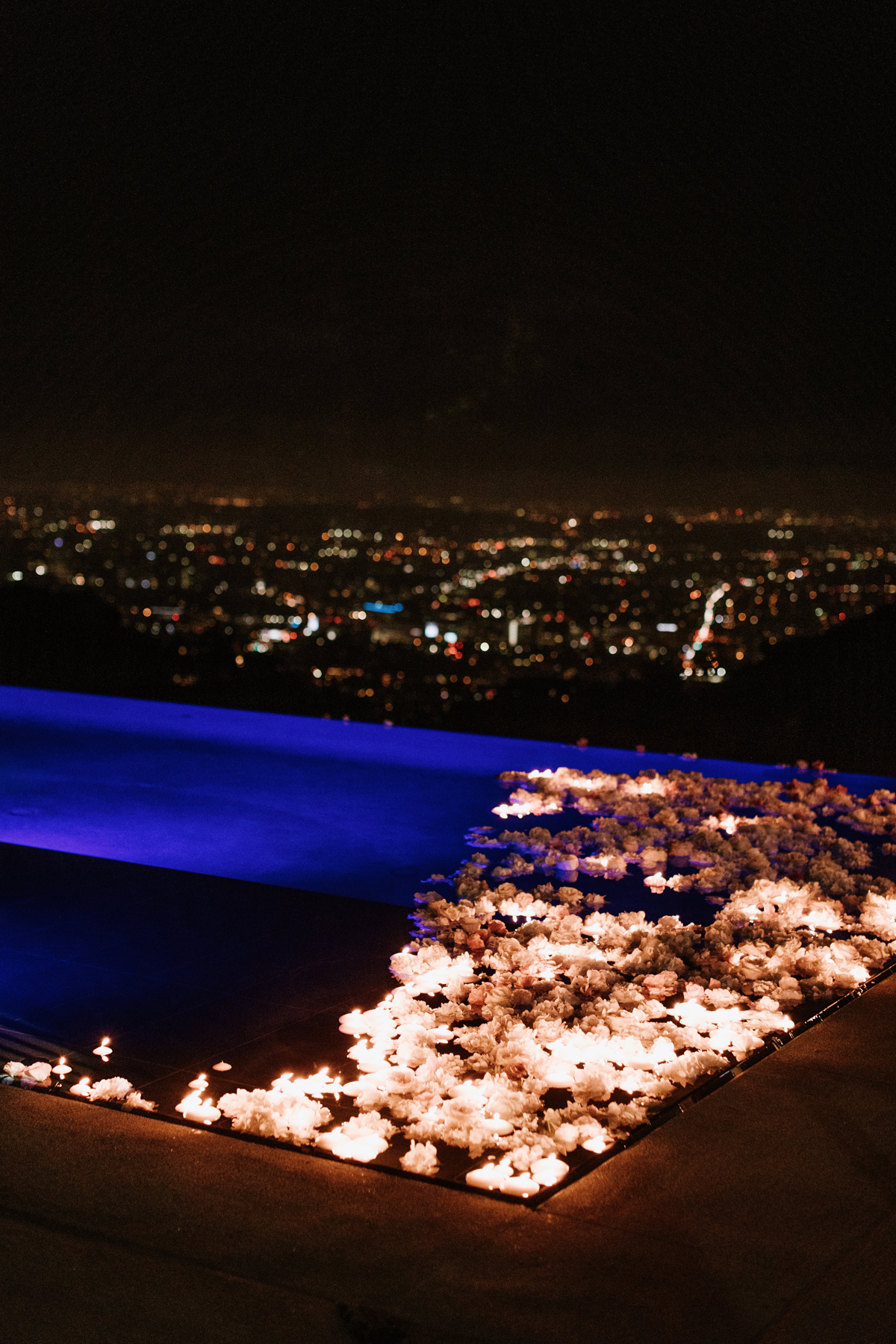 Dreamy Starry Nights Wedding pool filled with flowers overlooking los angeles.jpg
