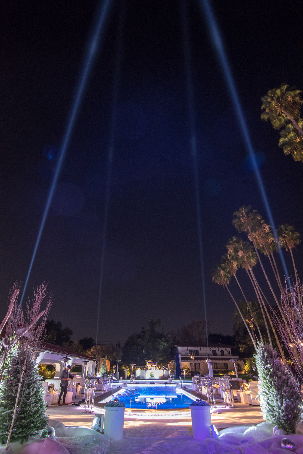 Narnia Inspired Opulent Winter Wonderland Party laser lights in the sky.jpg