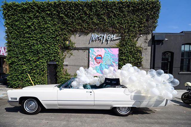 The ultimate Coachella getaway car to grab your Nasty Gals and go!  #thewotp #festivalseason #nastygalsdoitbetter #nastygal #balloons #dtla #losangeles #coachella #palmsprings