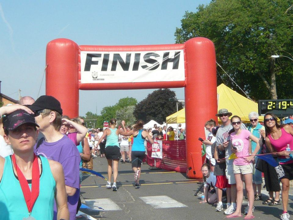 We crossed the finish line! You can to. Follow these tips to survive your first distance race.