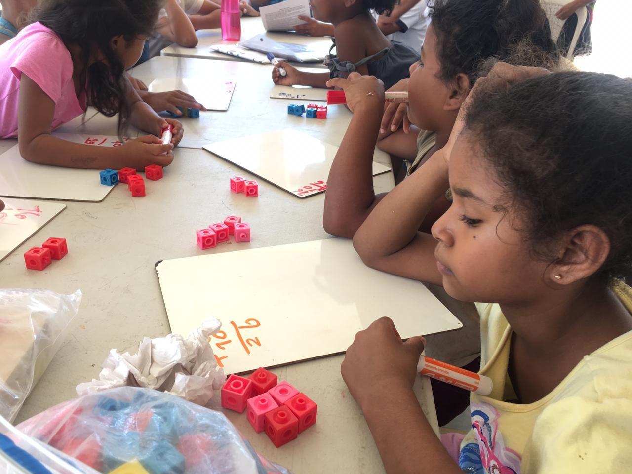Students use manipulatives donated by Seven Points Prep to enhance their math learning.