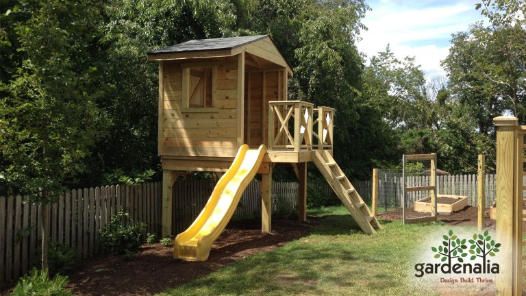 Wooden tree house project with mulching next to an edible garden!