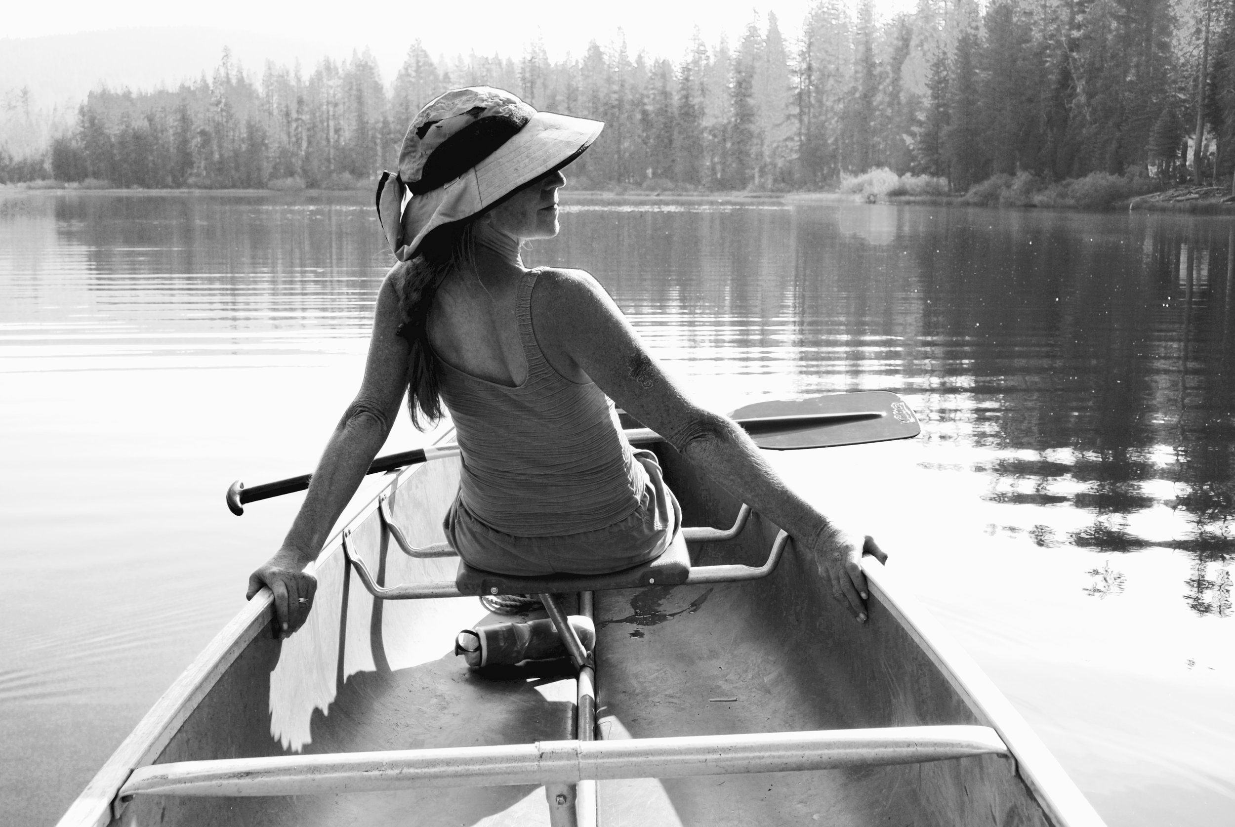 My sister Susan in the front of our canoe.