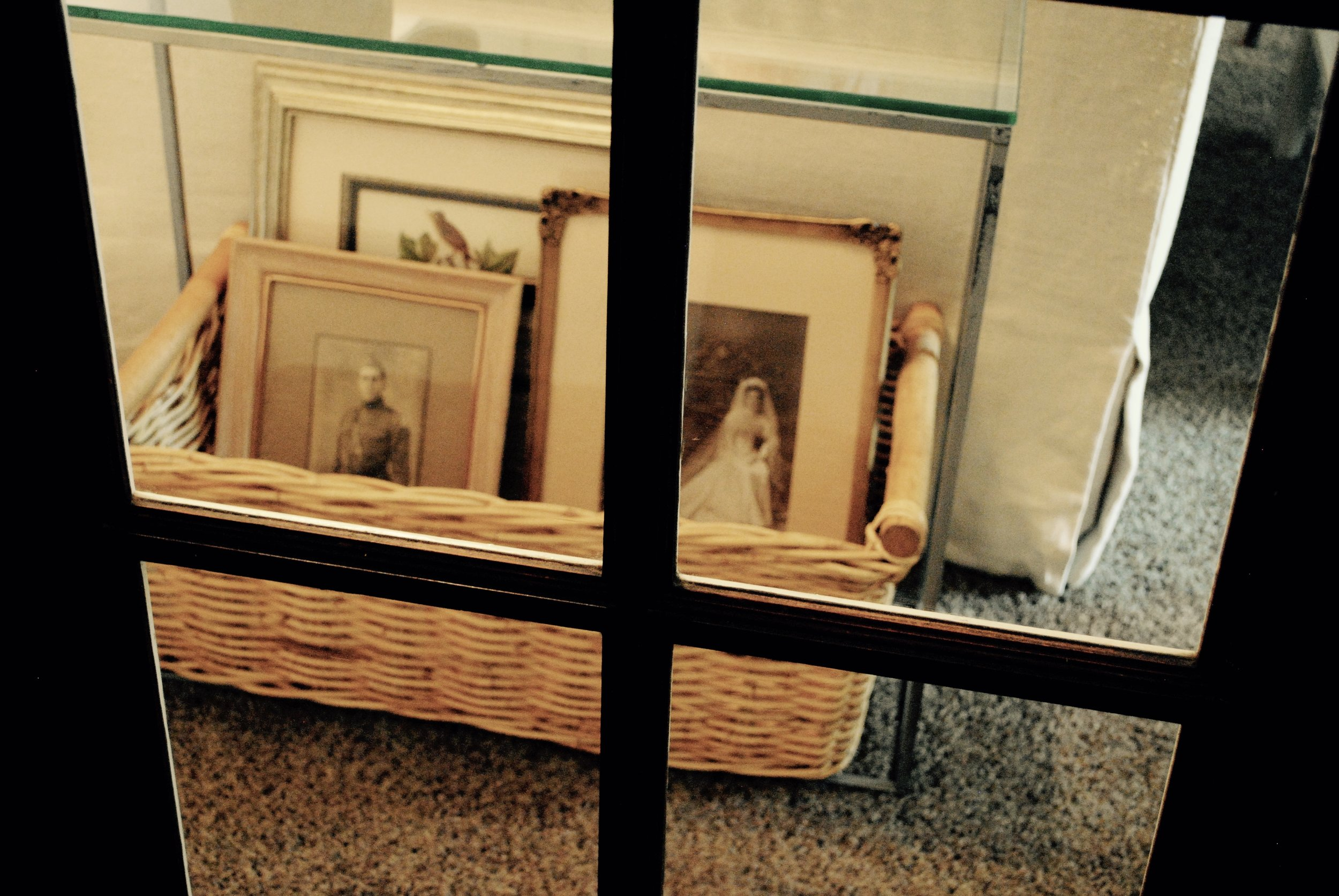 A basket seen through the french doors holds portraits of my paternal grandfather in his World War I uniform and my grandmother, Beth Campbell, in her wedding dress.