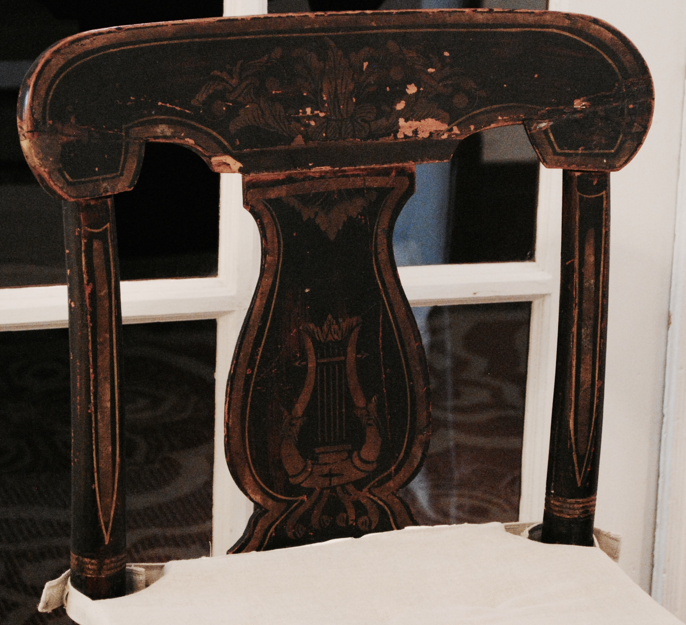 A Lyre-back Hitchcock side chair of Victorian vintage.