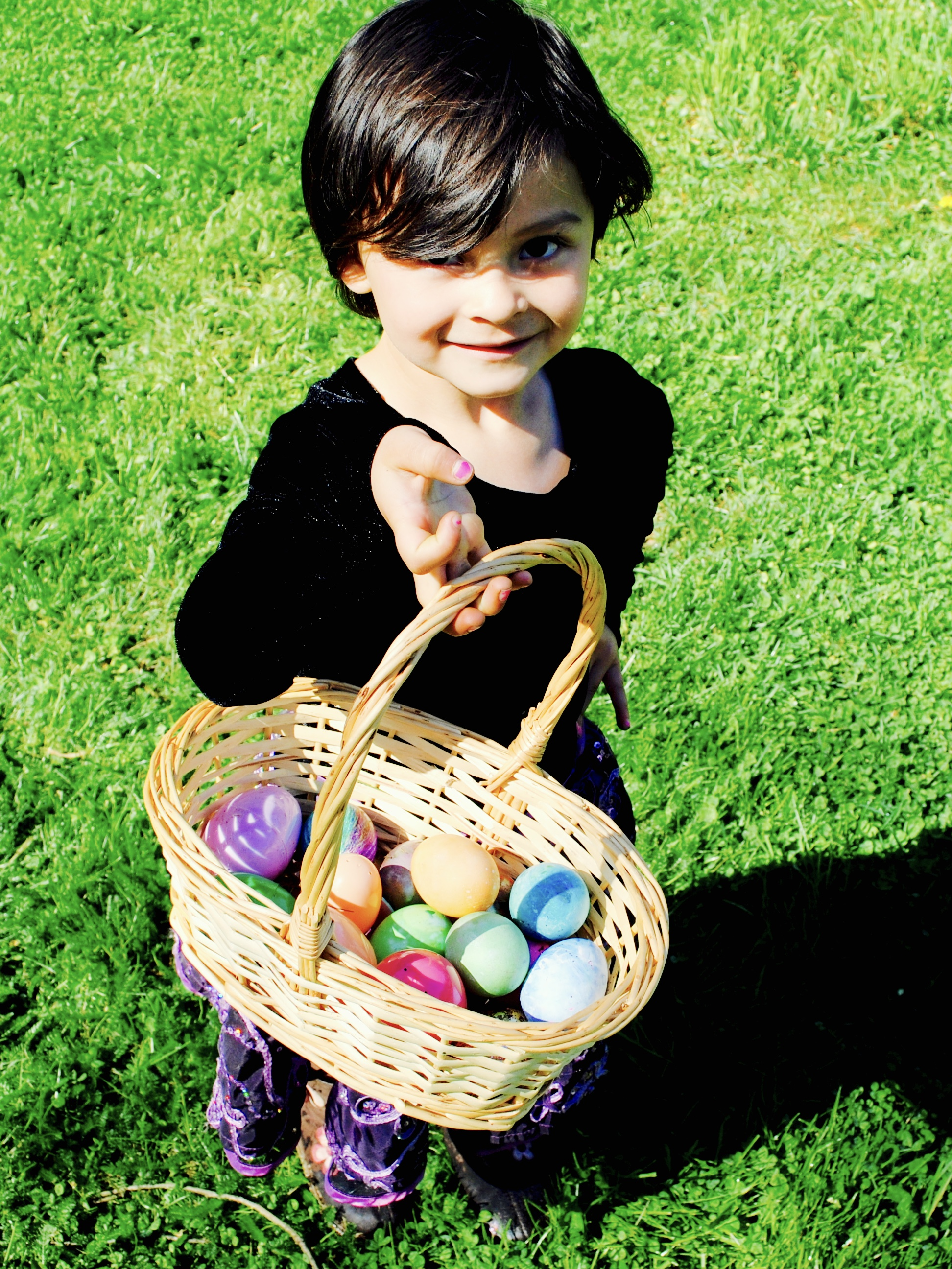 Lola with her basket of goodies, some filled with chocolates, some with finger puppets, some with colorful stickers.