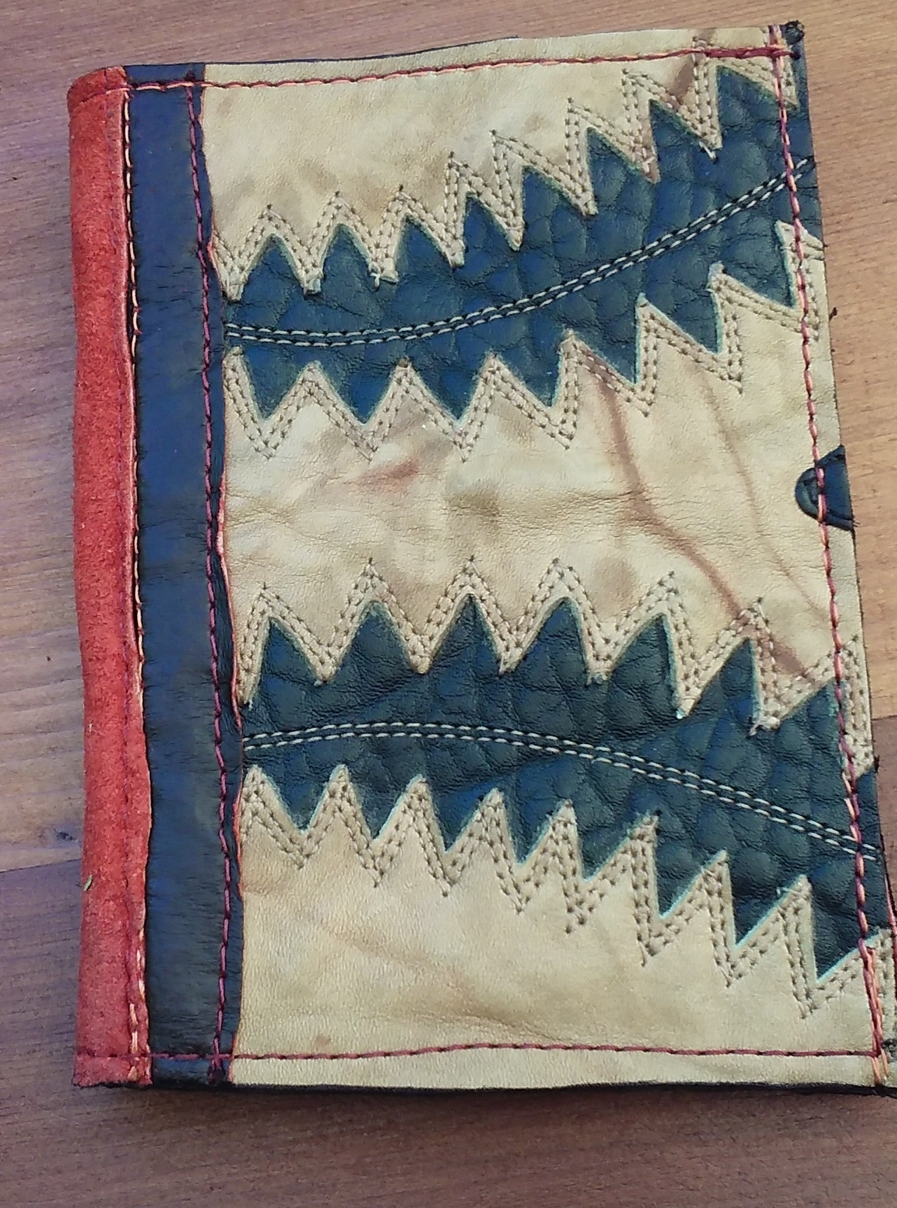 """4.5""""x 5.5"""", recycled leather and silk, $50"""