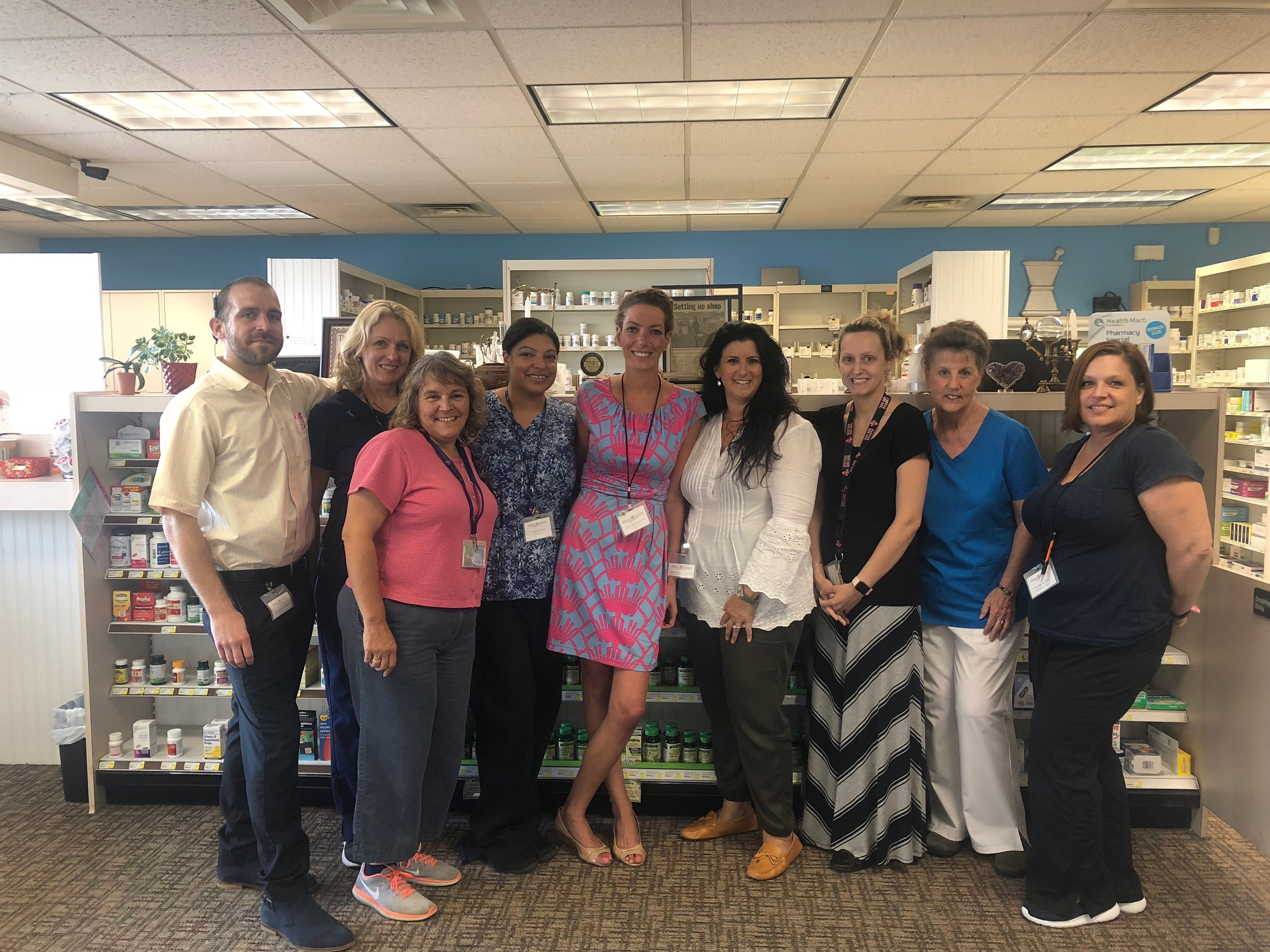 Karryn Lewis (center) and her staff at Whole Health Pharmacy