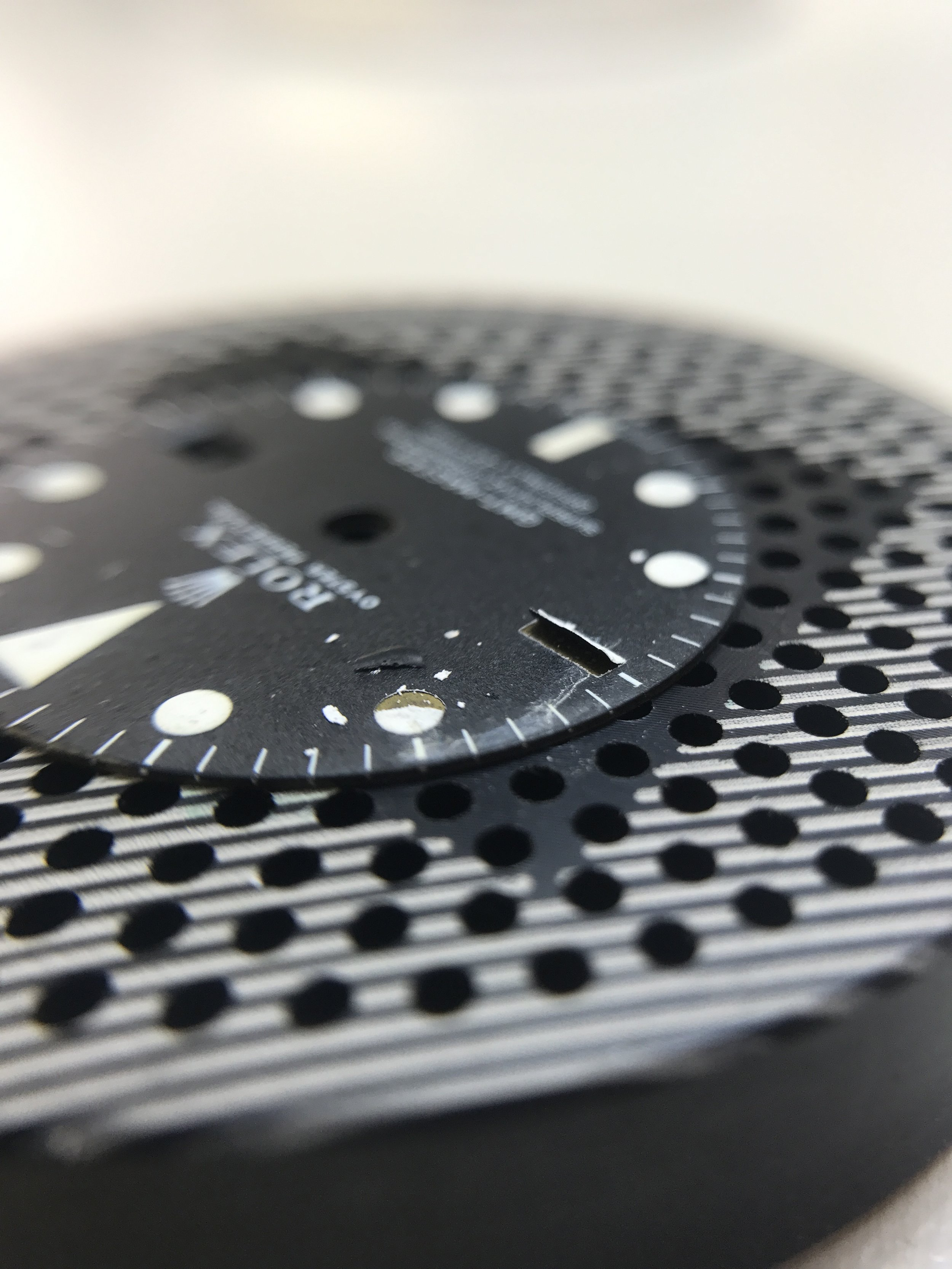 This is an example of a damaged flaking dial. This is definitely a necessary dial change.