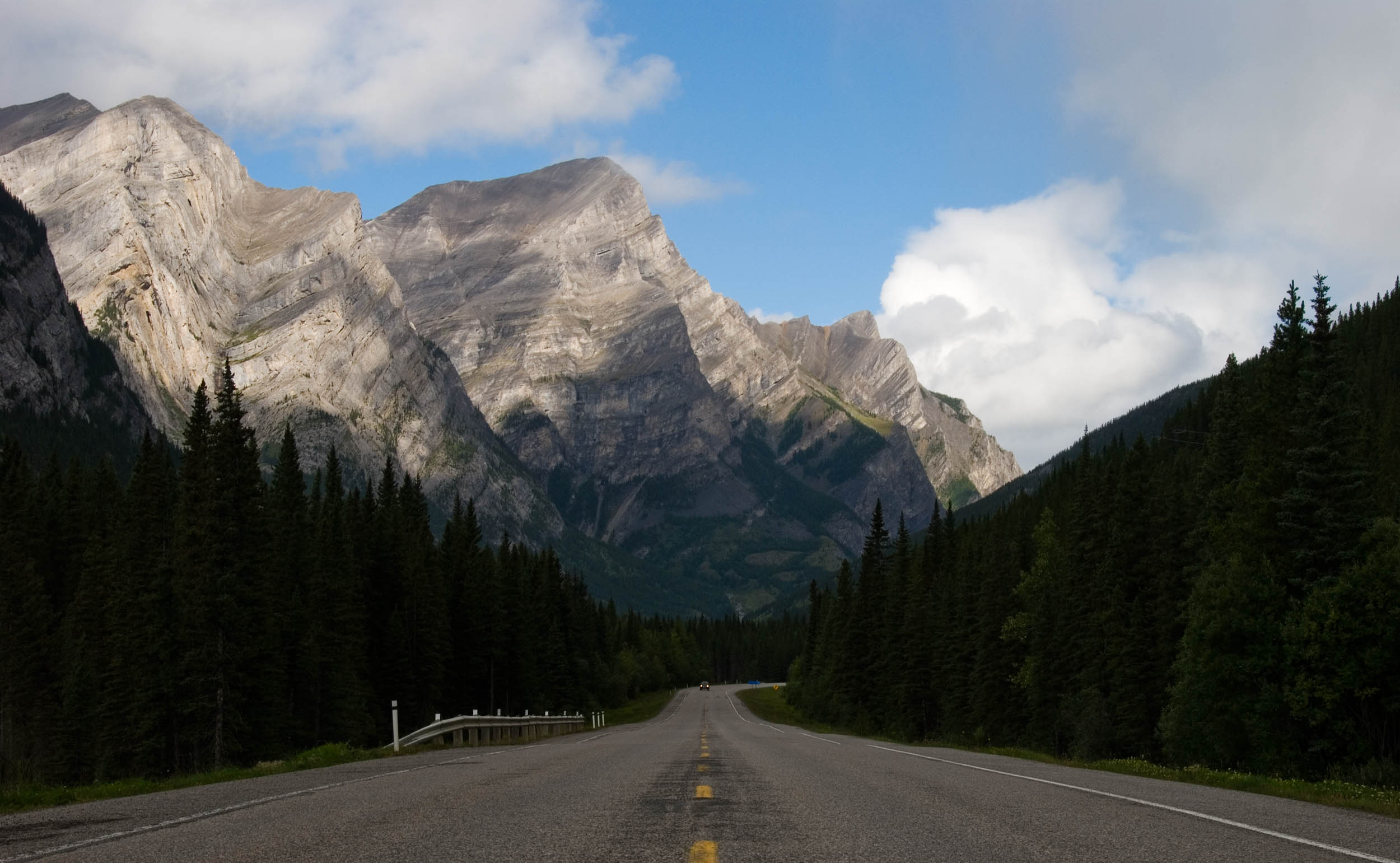 """In 2014 I had the privilege of visiting the Canadian Rockies. As a Canadian, living in Toronto, it left me wondering why I live I don't live in this part of the country (sorry Toronto!). I originally spotted this vista in the rear-view mirror of my car. I immediately pulled over and made this photograph. Since that day, my mantra while travelling has been, """"Don't forget to check the view behind you!""""  This photo is of the Mt. Kidd on the Kananaskis Trail Highway just outside of Canmore, Alberta."""