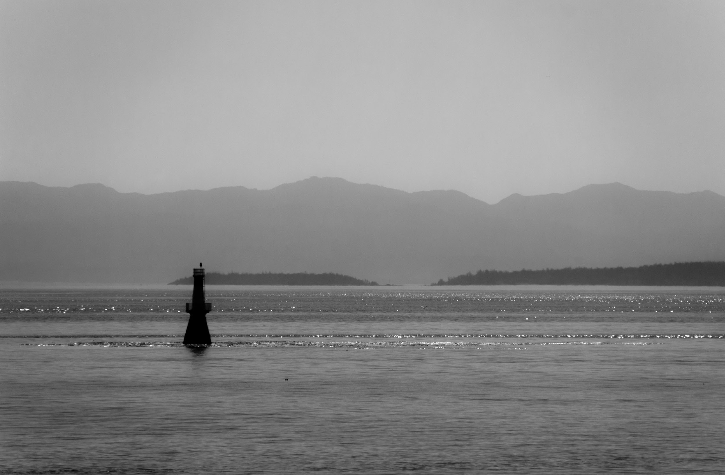 A lighthouse in shadow in the Haro Strait in BC