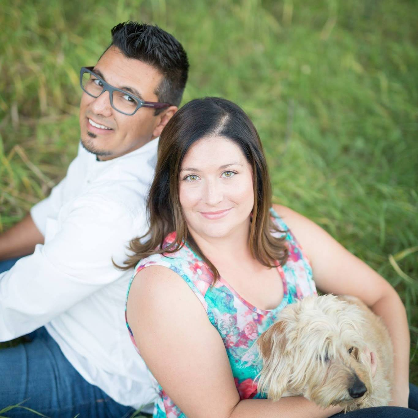 Youth Director Eric Chavez and his wife, Shanna, with their dog, Buster