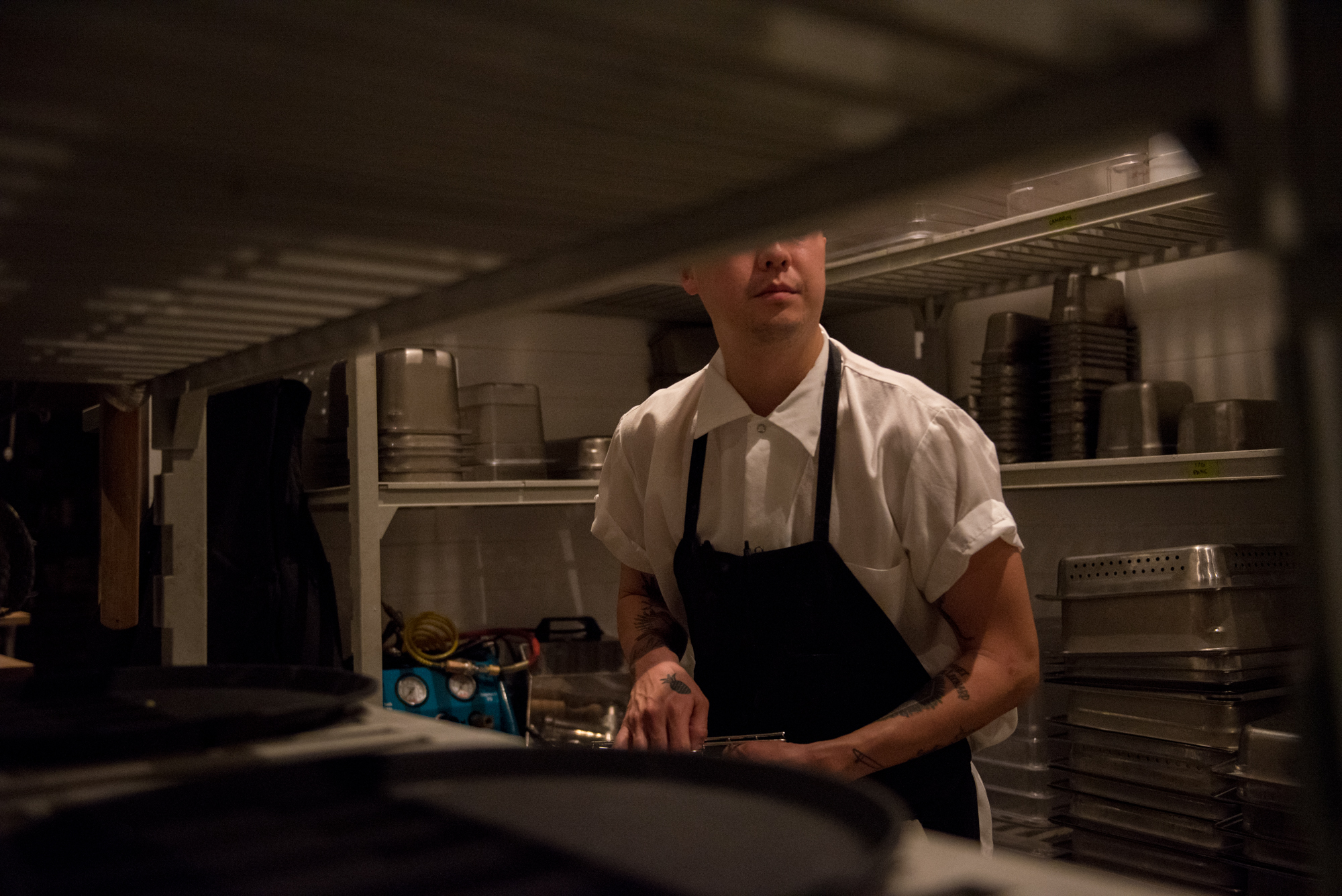 Eric Ehler works late in the kitchen at Mister Jiu's on Wednesday, March 21, 2018. | Rosa Furneaux, Special To The Chronicle