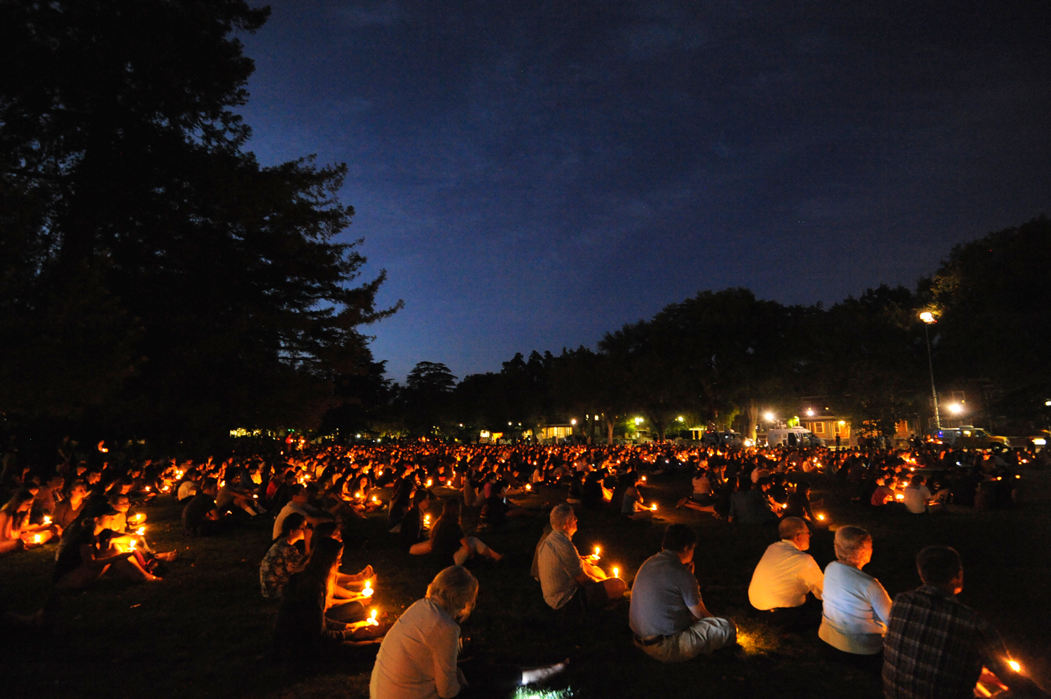 Students, faculty, and members of the public fill the East Quad at UC Davis during a candlelit vigil for the victims of UC Santa Barbara shooting on Friday, May 30, 2014. | Rosa Furneaux/The California Aggie