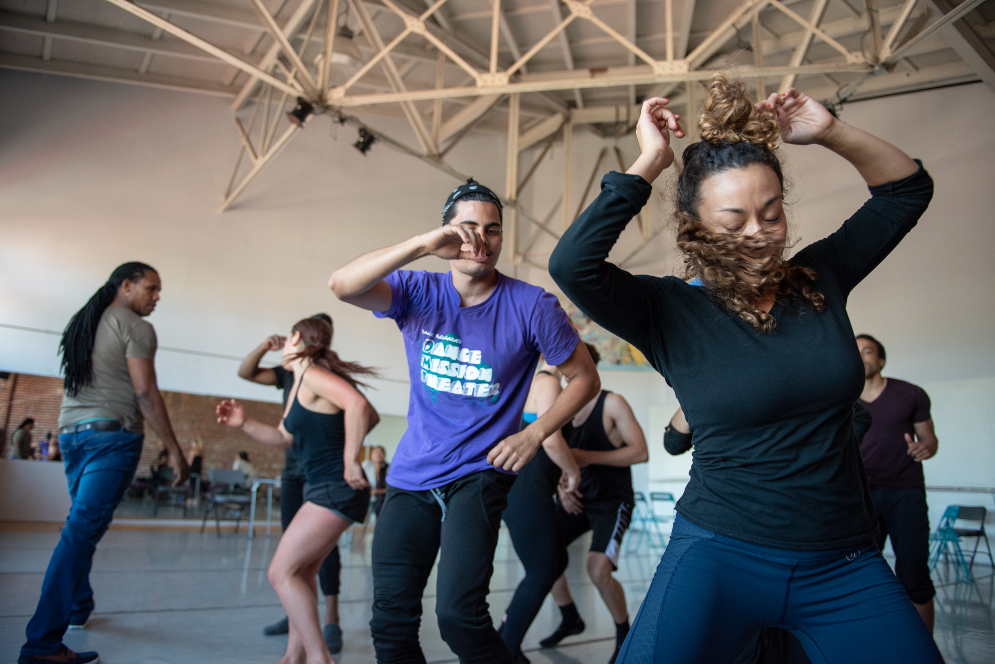 Dancers Adonis Martin Quiñones (center wearing purple shirt) and Jillian Miller (right) dance a rumba with other members of the Alayo Dance Company, as artistic director Ramon Ramos Alayo looks on, during a rehearsal for the upcoming Cuba Caribe Festival, in San Francisco on Friday, June 1, 2018. | Rosa Furneaux, Special To The Chronicle