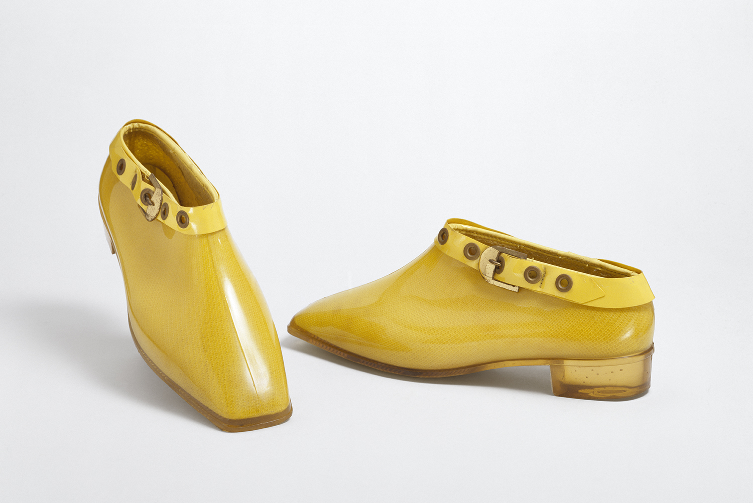 Yellow ankle boots in Polyvinyl chloride (PVC) lined with cotton jersey, Mary Quant, 1967, London. Museum no. T.591: 1&2-1992. © Victoria and Albert Museum, London