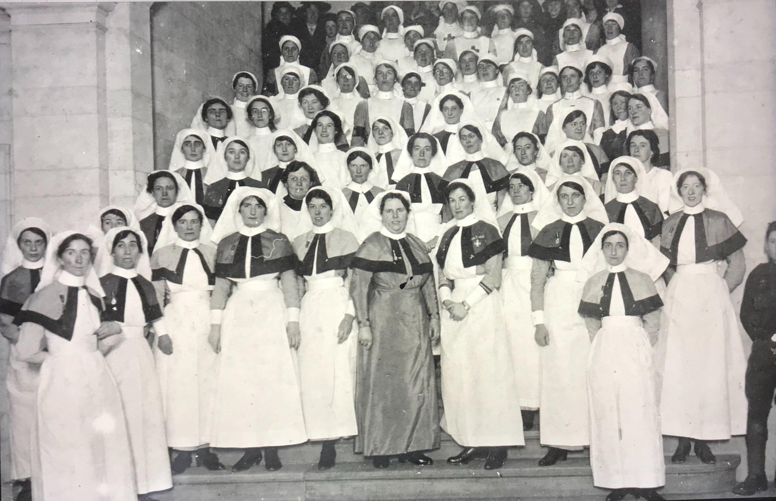 Nurses on steps of main building