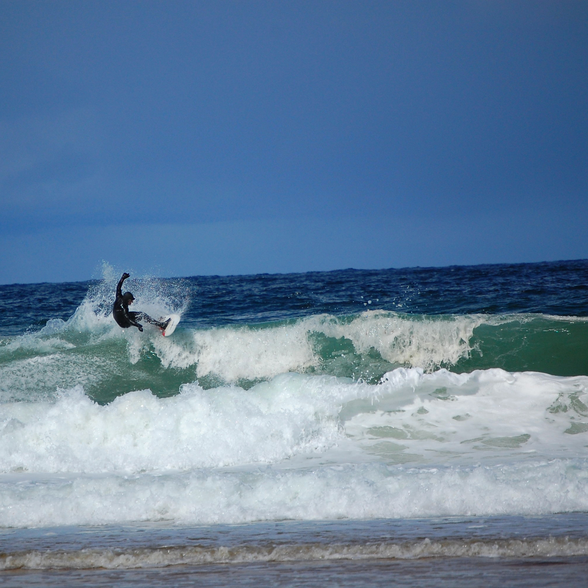 A surfer in big waves