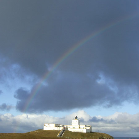 Strathy lighthouse and a rainbow