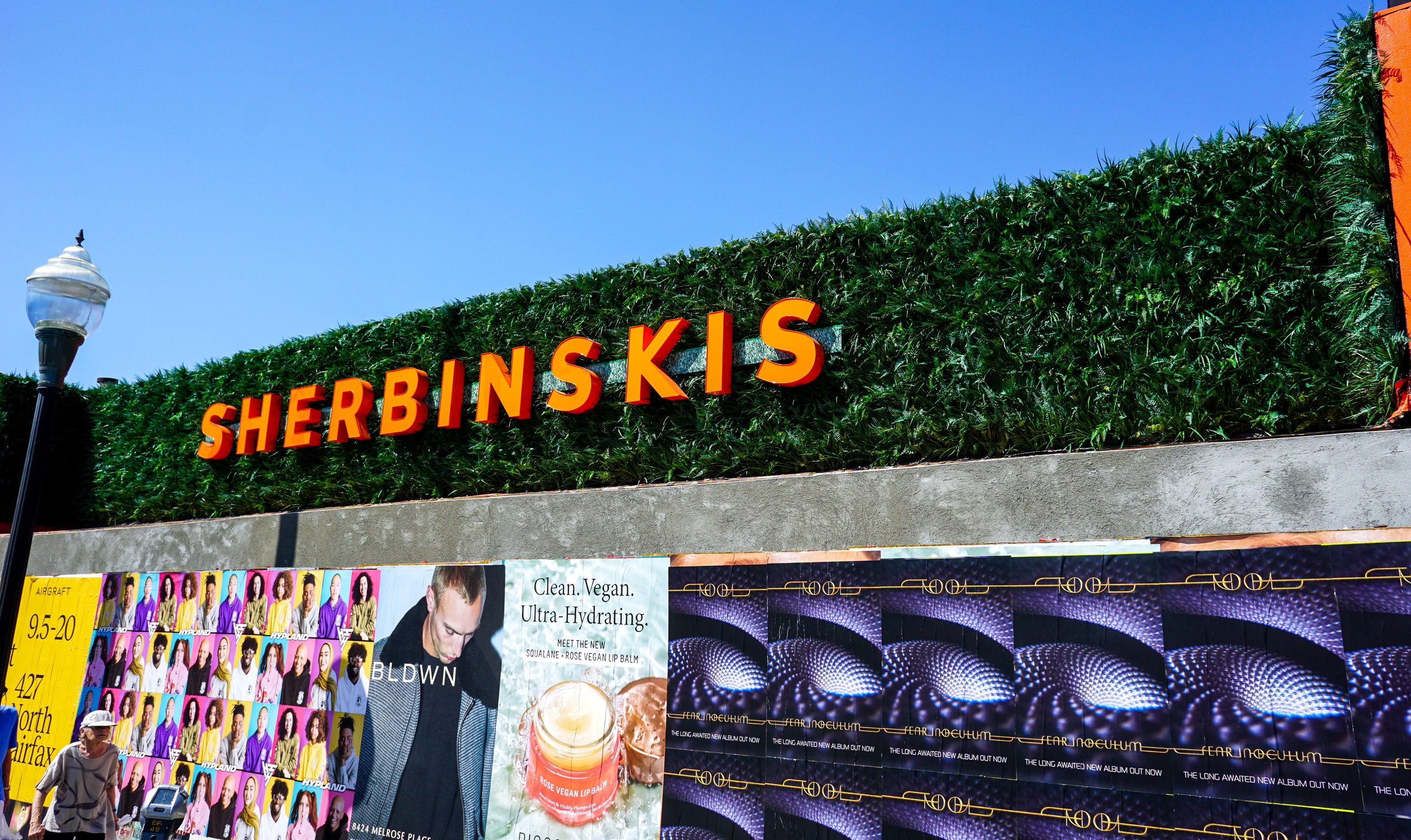 ALW Installation at Sherbinskis in LA  This client wanted plants to surround the signage on the exterior of their new space in LA, but did not want the upkeep of live plants. We created a custom design with our artificial living wall panels to suit their needs.