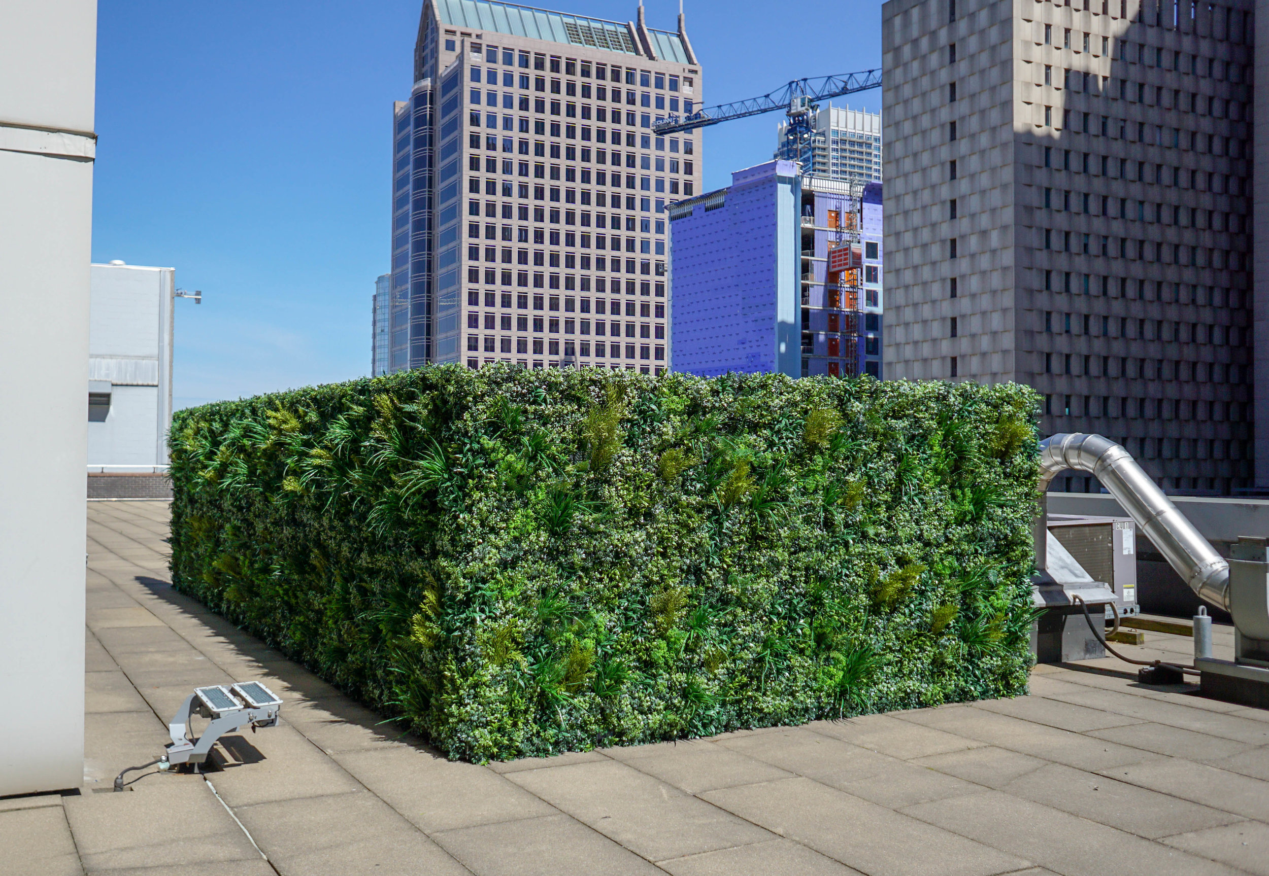 ALW HVAC Screen - Charlotte, NC  Our client wanted a solution to hide unsightly HVAC equipment outside a 5th floor suite in Uptown Charlotte. We used Lush Green panels for this outdoor project.