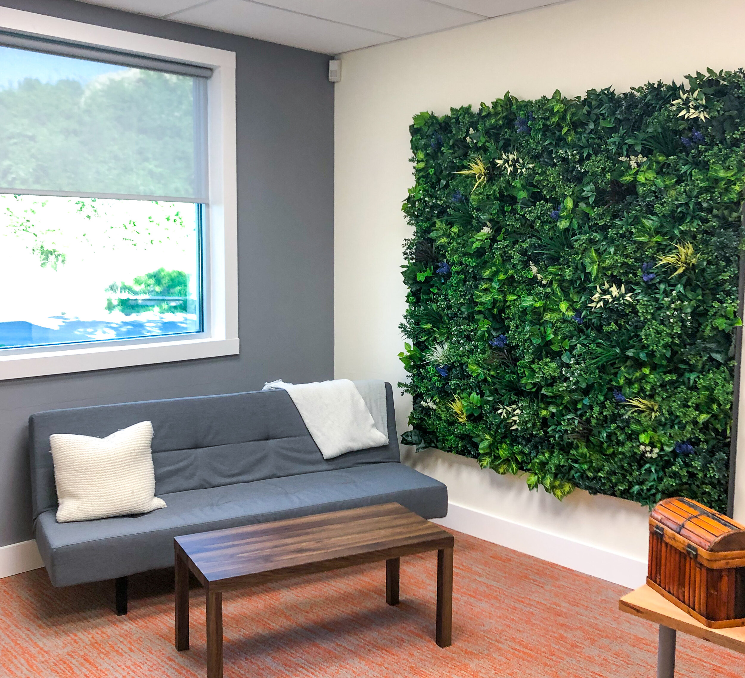 Leafy ALW Panels with Optional Colorful Plants  A 6'x6' artificial living wall installation at our office in Charlotte, NC. Several varieties of colorful plants were added to these Leafy Panels.