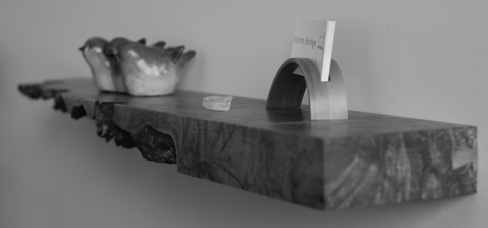 Floating Maple Burl shelf with an aluminum sliding dovetail wall mount