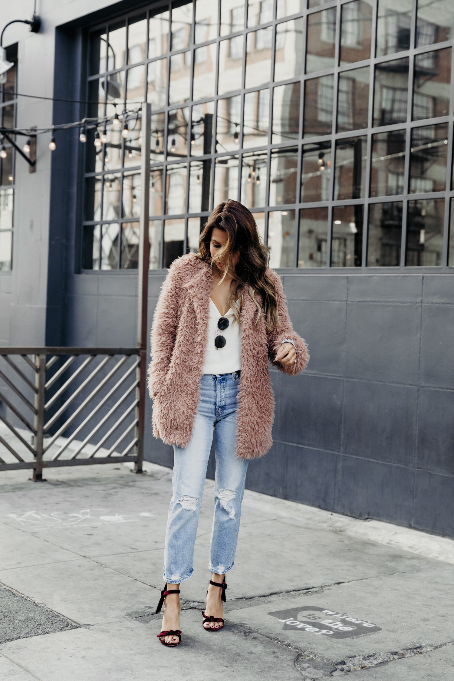 fuzzy jacket outfit, how to wear heels and jeans, friendsgiving outfit ideas
