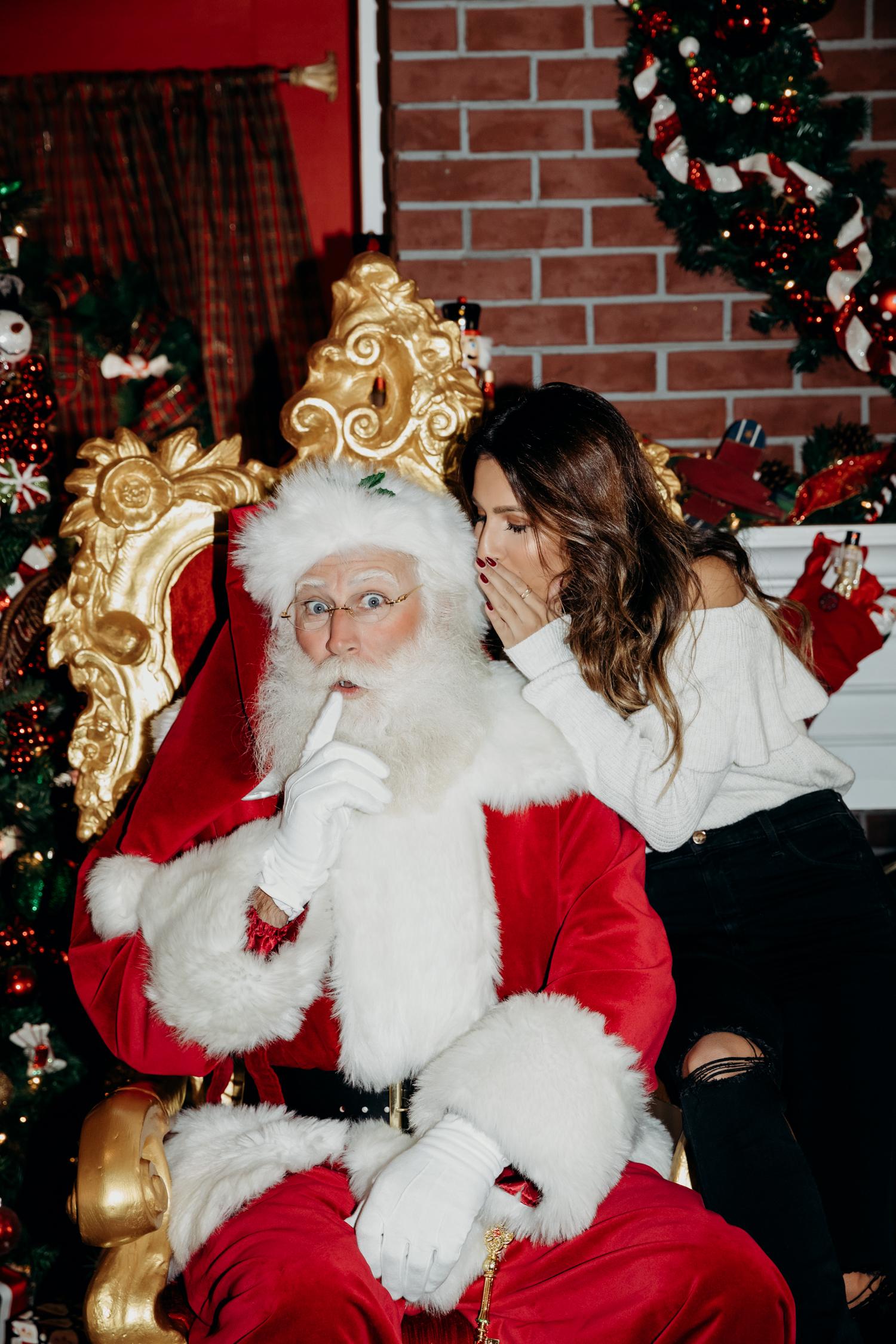 Ashley from Everyday Pursuits visiting Santa at the Americana