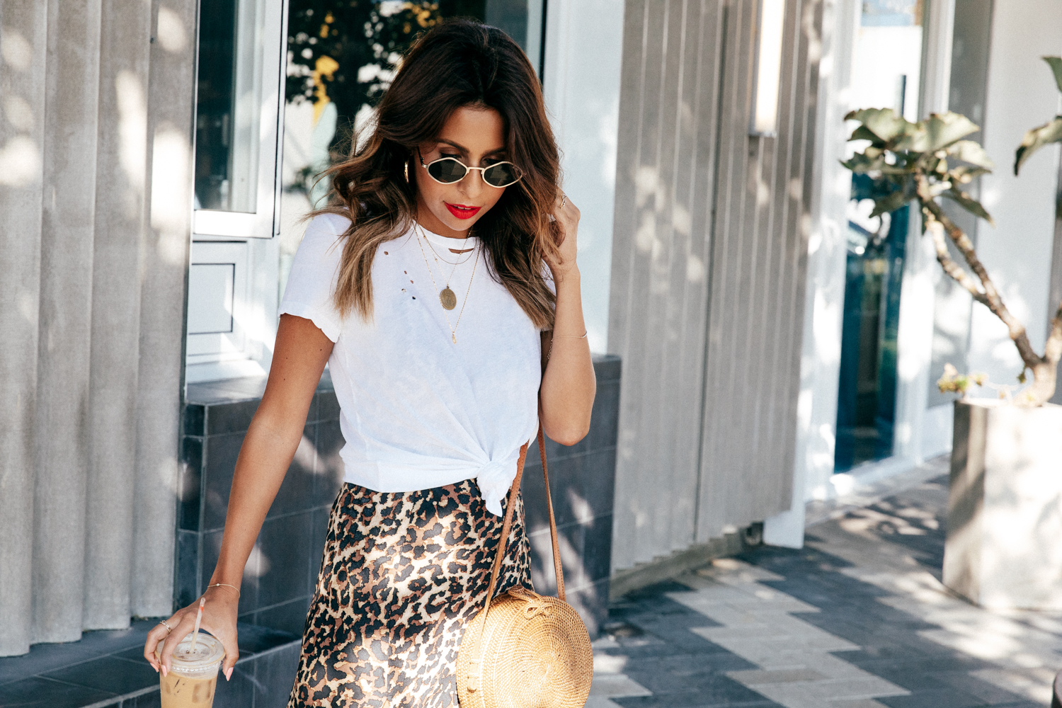White T-shirt and leopard skirt outfit via Everyday Pursuits
