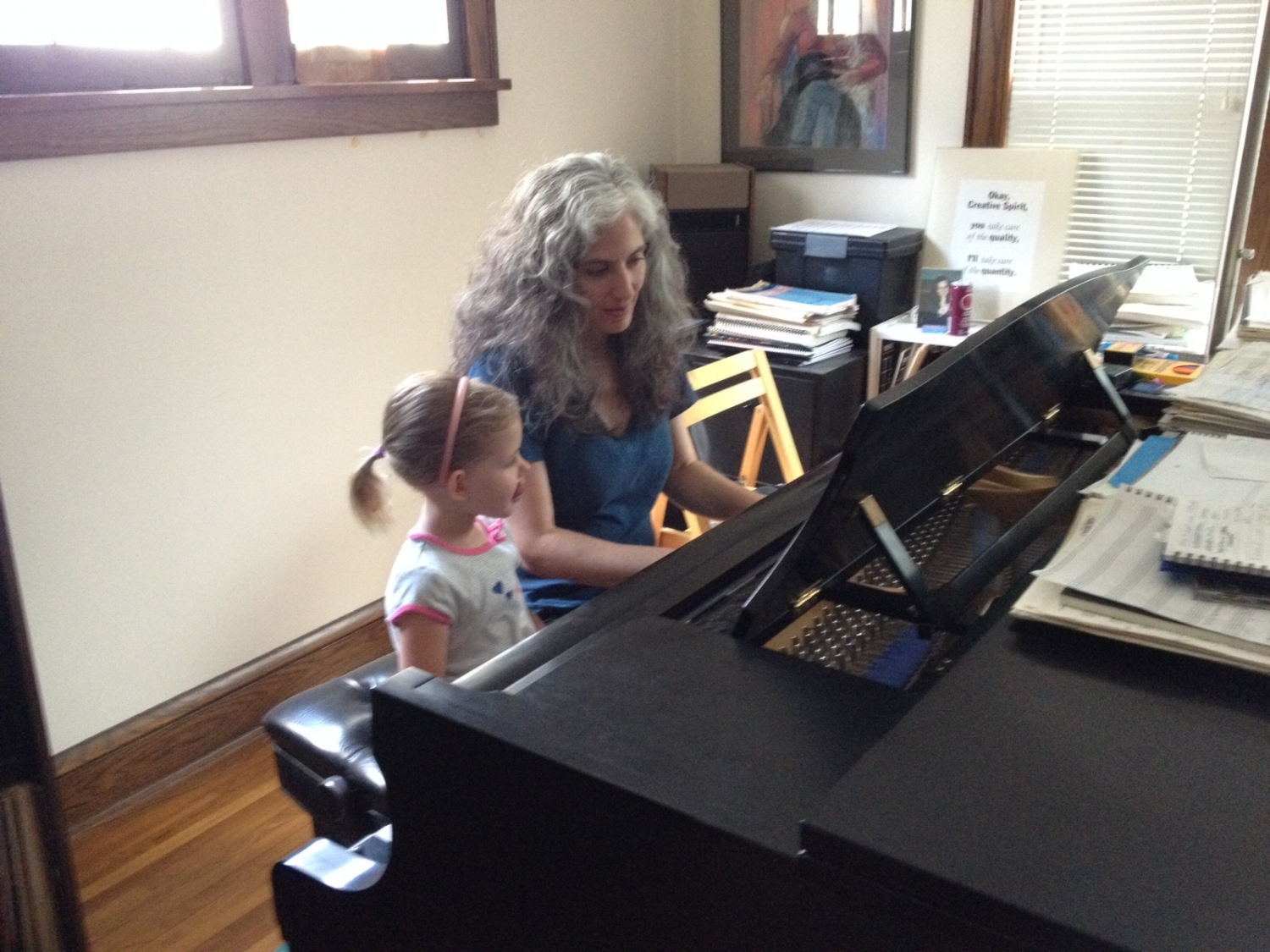 Pianist Mary Louise Knutson teaching a private lesson.