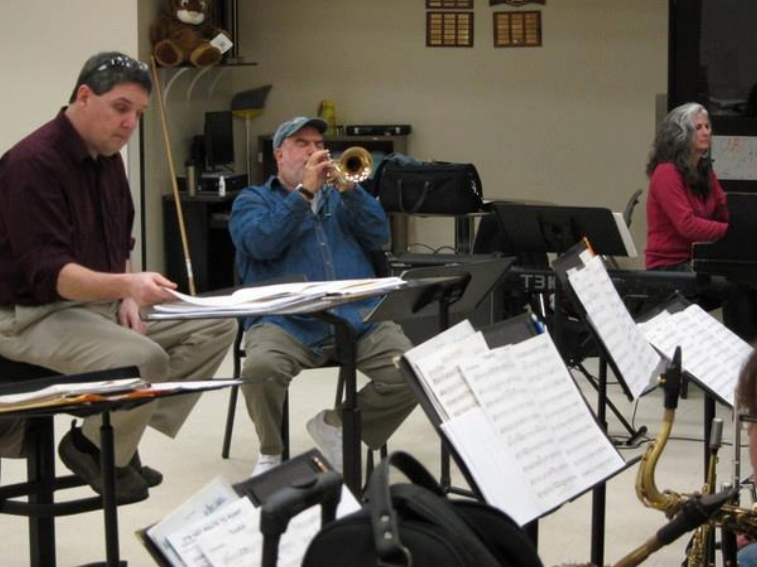 Pianist Mary Louise Knutson rehearsing with trumpeter Randy Brecker (center), JazzMN Orchestra director Doug Snapp (left), and JazzMN Orchestra (not pictured), Minneapolis, MN.