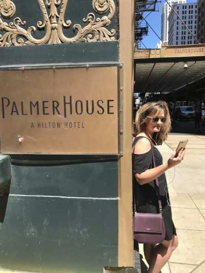 Ashley Hasty reading Commonwealth by Ann Patchett at the Palmer House in Chicago