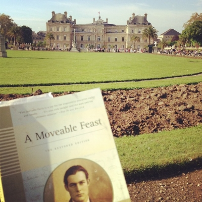 Reading A Moveable Feast by Ernest Hemingway at the Luxembourg Gardens in Paris, France