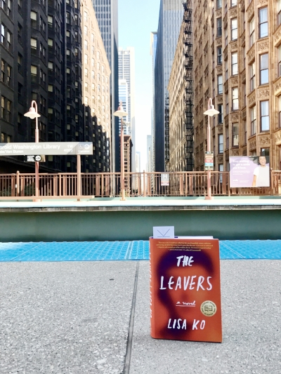 Reading The Leavers by Lisa Ko at the Harold Washington Library L stop in Chicago