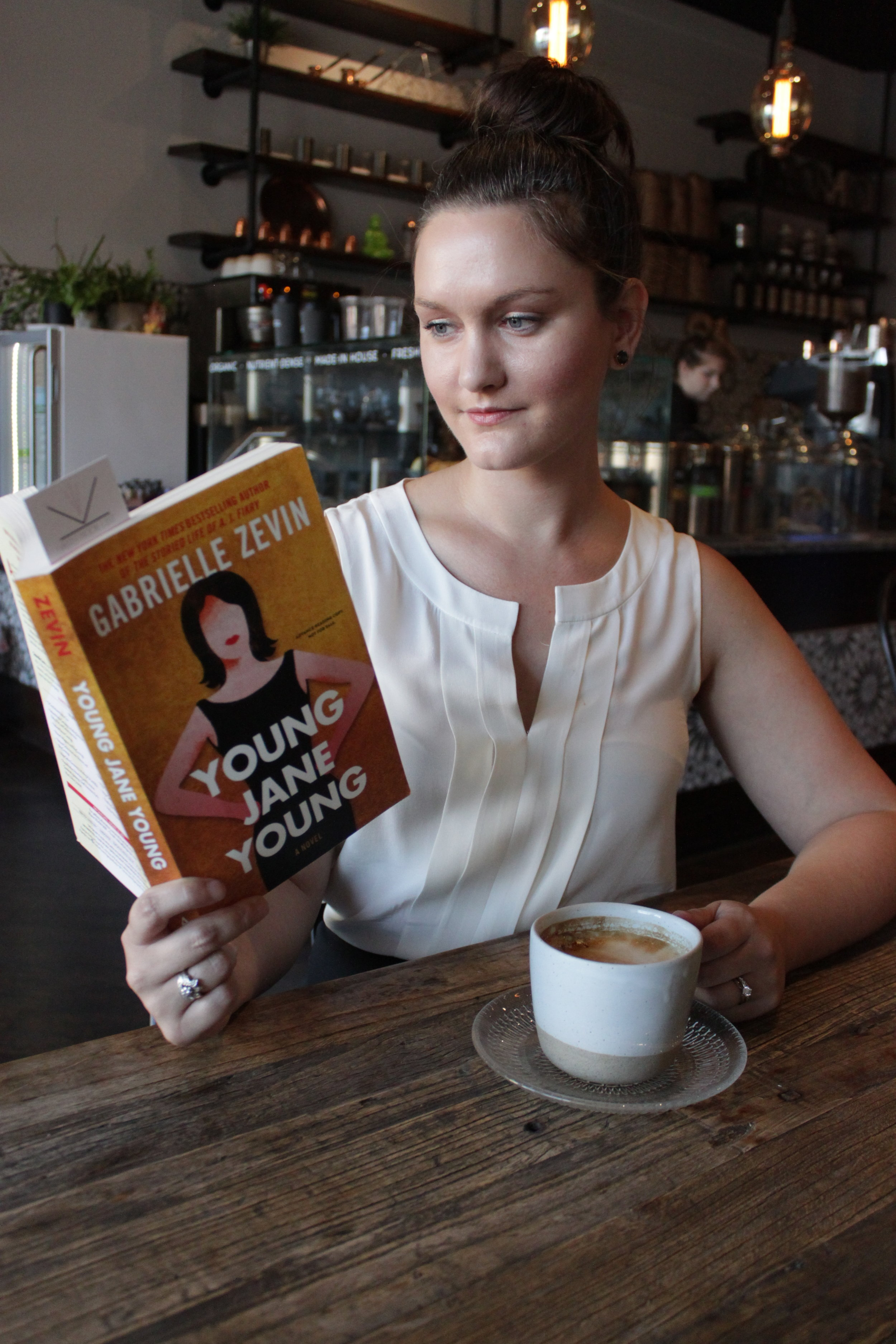 Reading Young Jane Young by Gabrielle Zevin at Oromo Cafe
