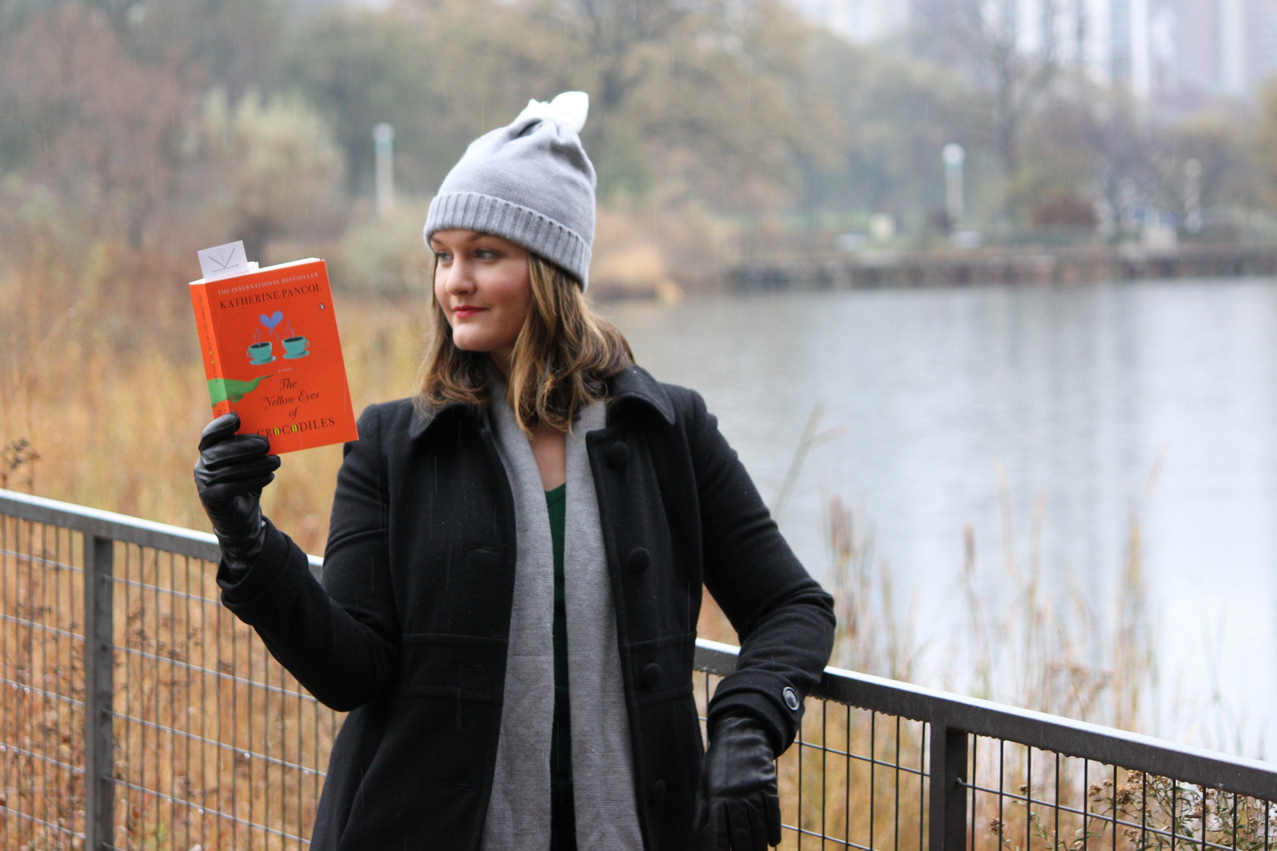 Reading The Yellow Eyes of Crocodiles by Katherine Pancol at Lincoln Park in Chicago