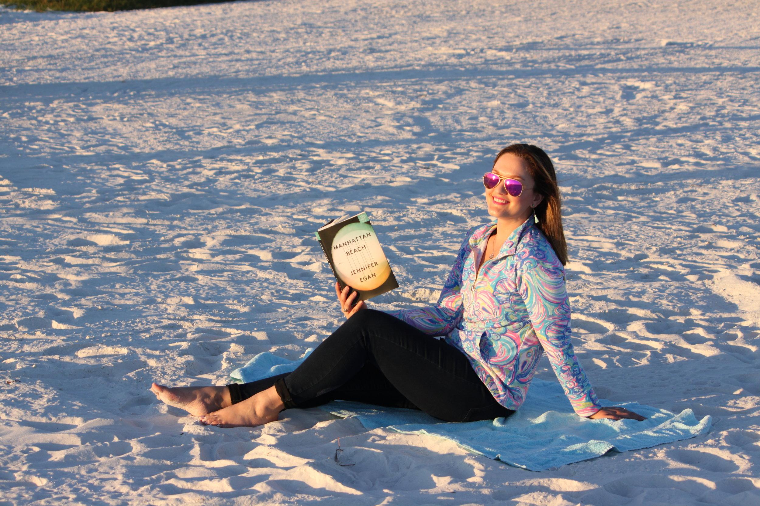 Reading Manhattan Beach by Jennifer Egan on Siesta Key Beach