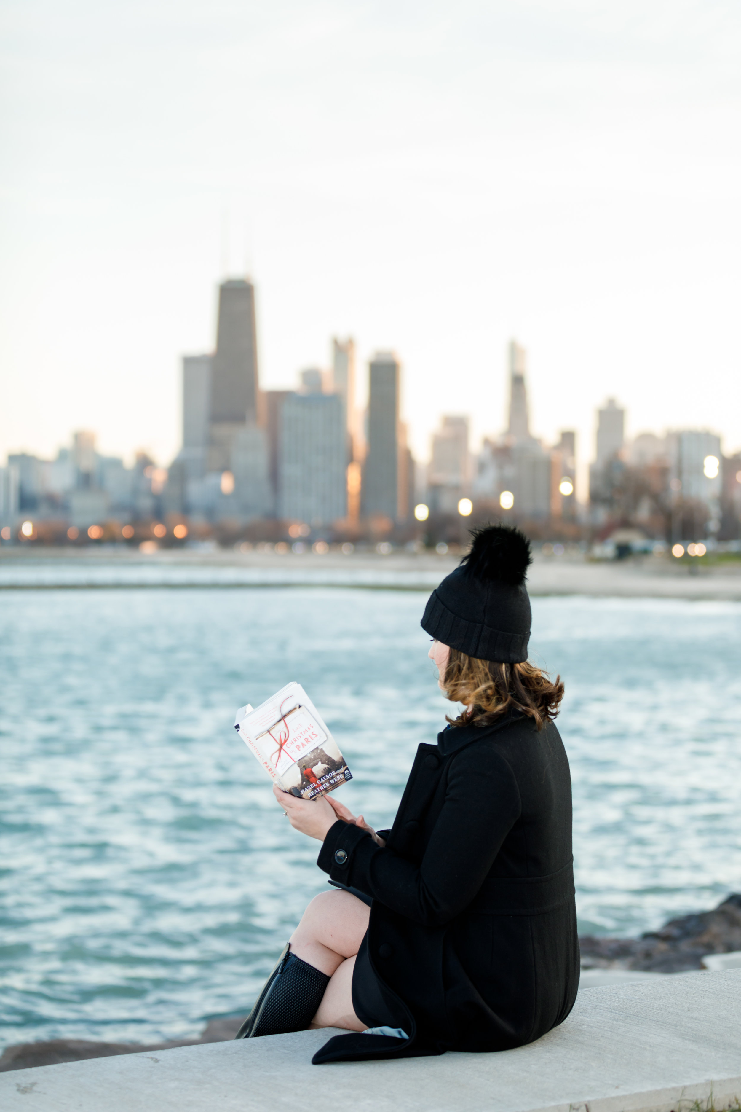 Reading Last Christmas in Paris by Hazel Gaynor and Heather Webb by Lake Michigan in Chicago | Photo by Kathleen Virginia Photography