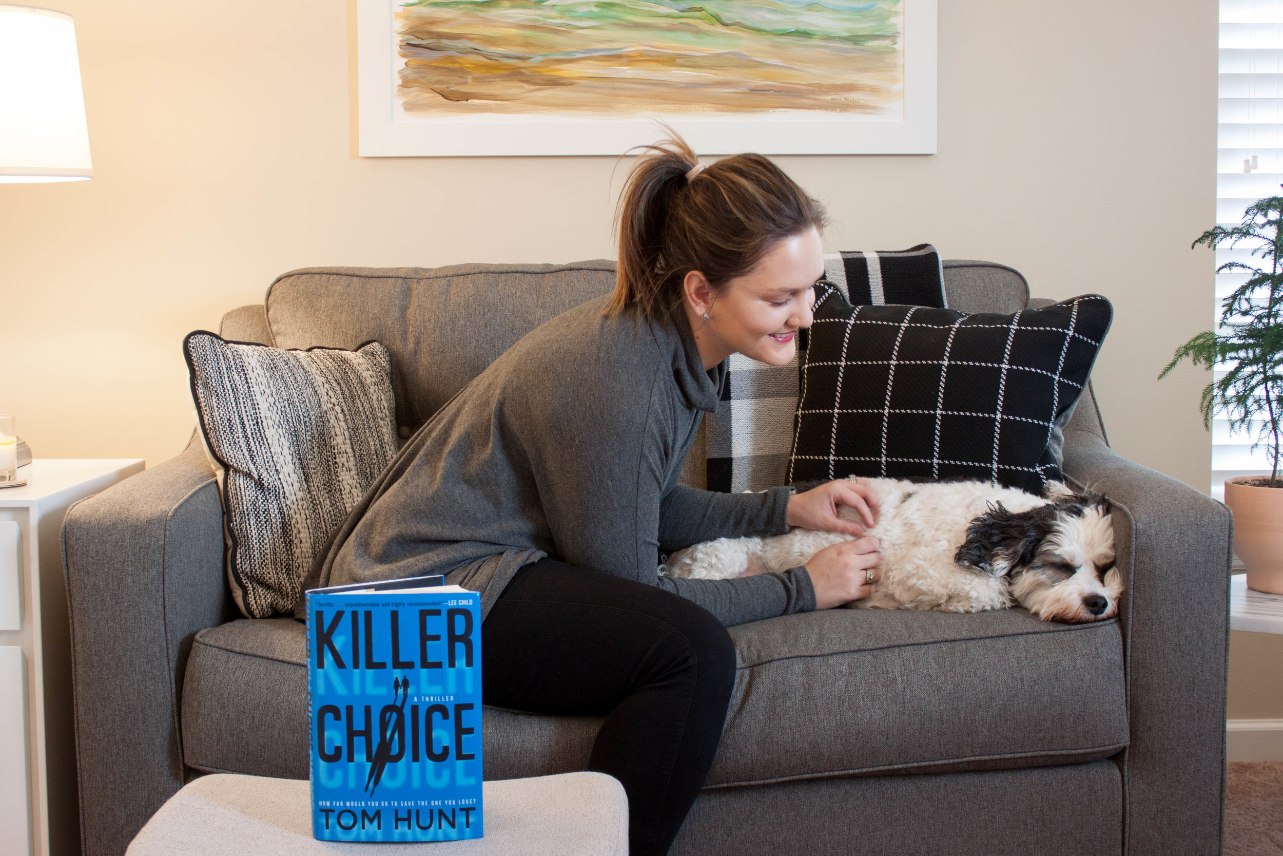 Reading Killer Choice by Tom Hunt at home with my dog, Huxley