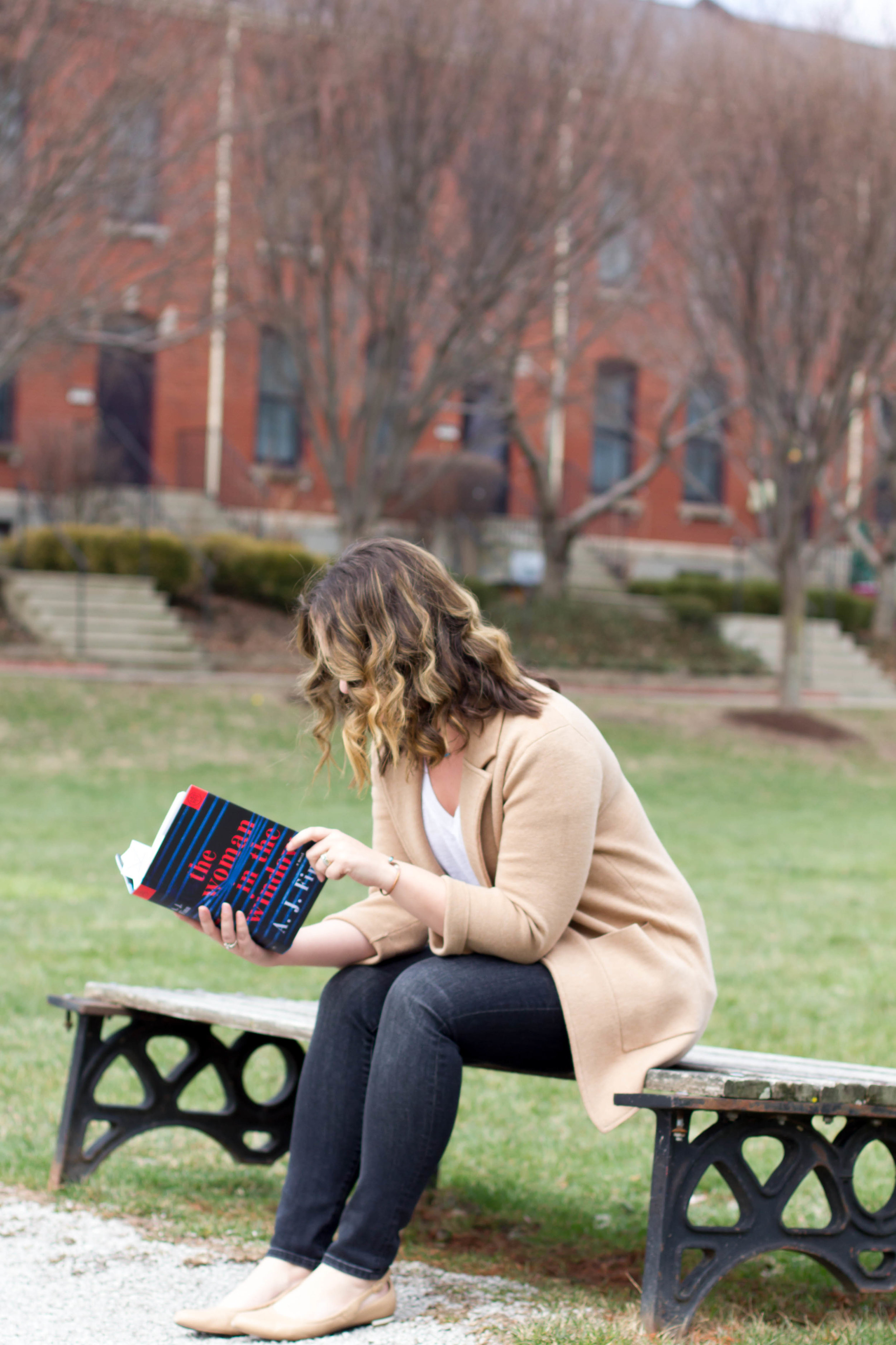 Reading The Woman in the Window in New Town at St. Charles, MO