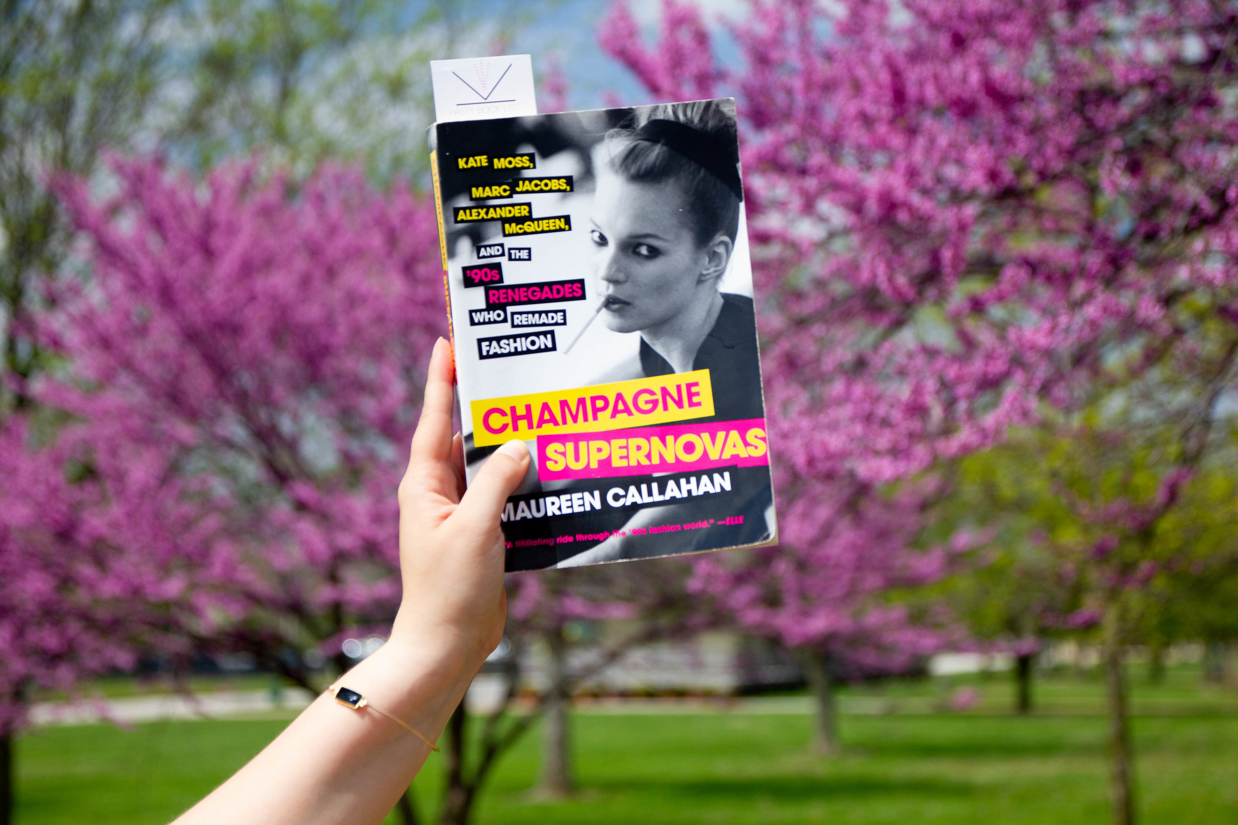 Reading Champagne Supernovas by Maureen Callahan by the Missouri River in Historic St. Charles, MO