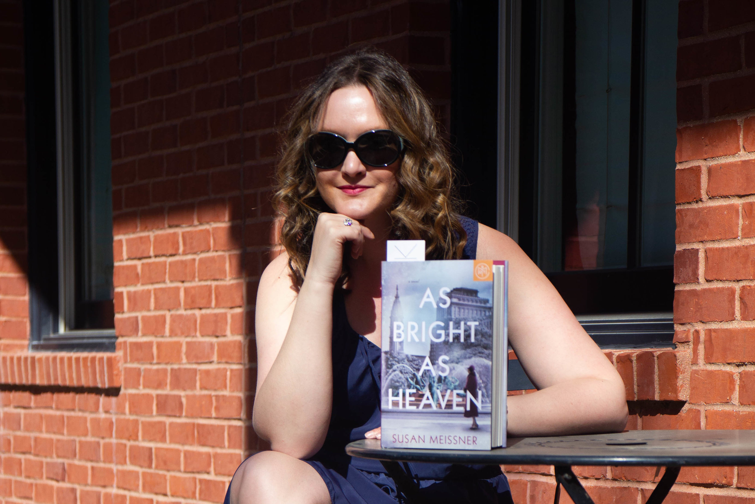 Reading As Bright As Heaven by Susan Meissner in New Town at St. Charles, MO (but it could be a cafe in France, no?)