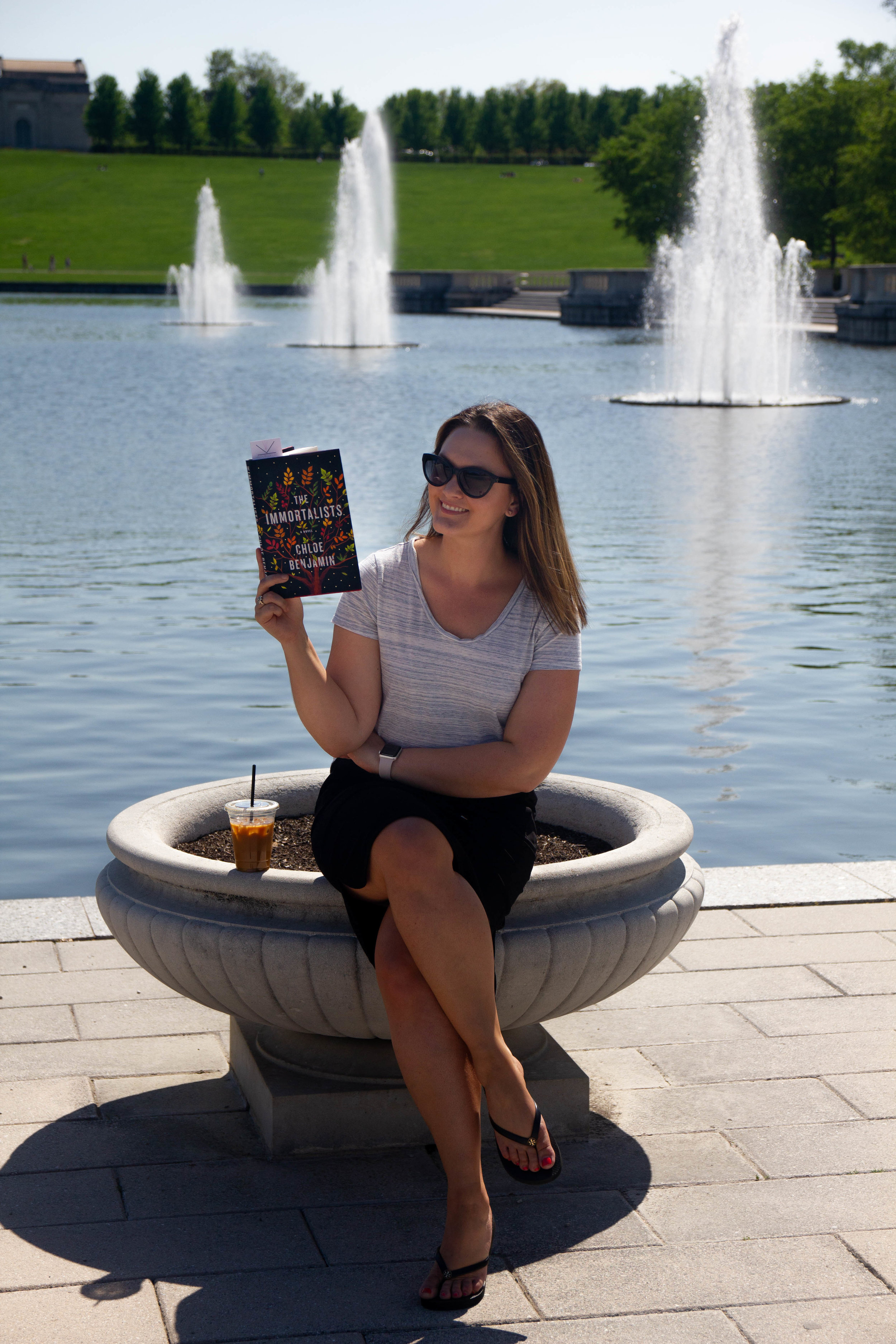 Reading The Immortalists by Chloe Benjamin at the Grand Basin outside the St. Louis Art Museum