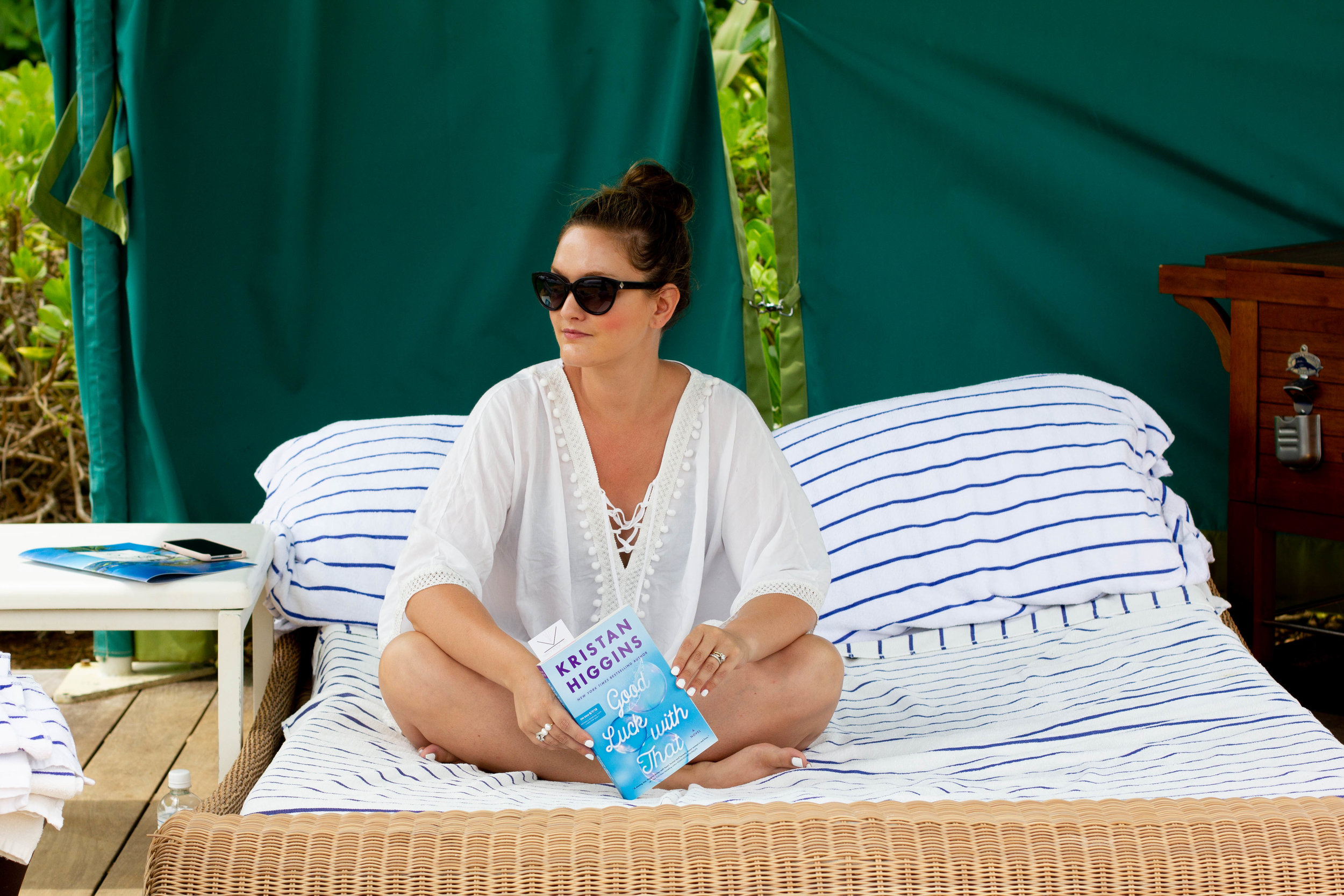 Reading Good Luck with That by Kristan Higgins at St. Regis in Kauai