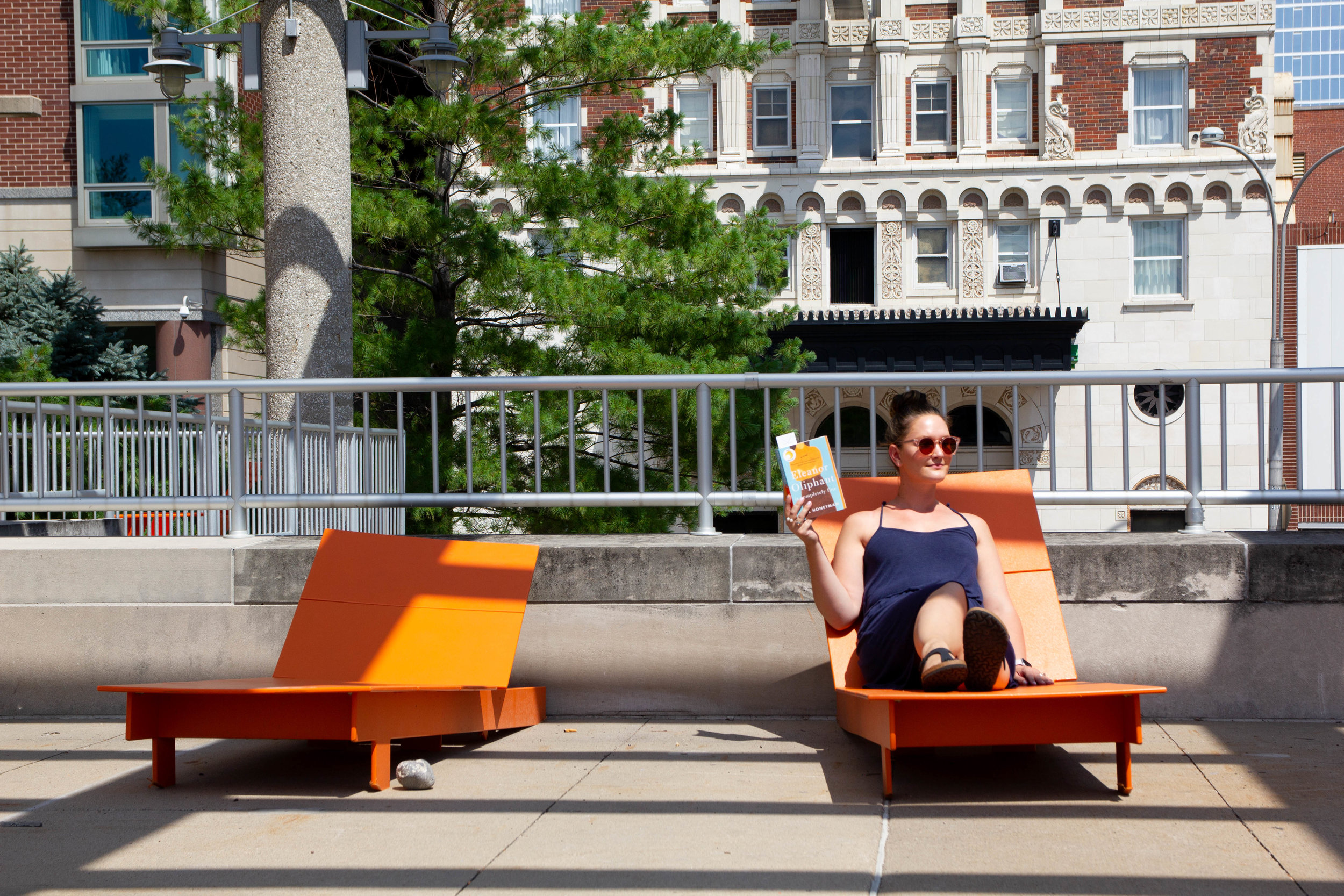 Reading Eleanor Oliphant is Completely Fine in Barney Allis Plaza in Kansas City, MO